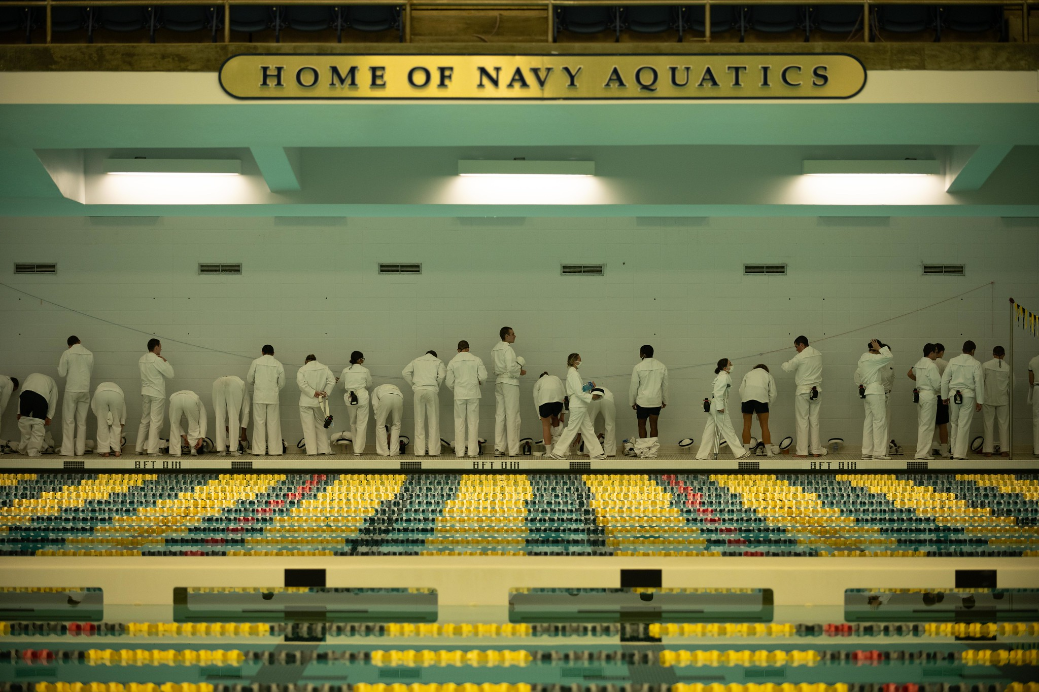 Midshipmen 4th Class, or plebes, from the United States Naval Academy Class of 2024 complete swim training on Aug. 5, 2020, during Plebe Summer, a demanding indoctrination period intended to transition the candidates from civilian to military life. (MC2 Nathan Burke/Navy)