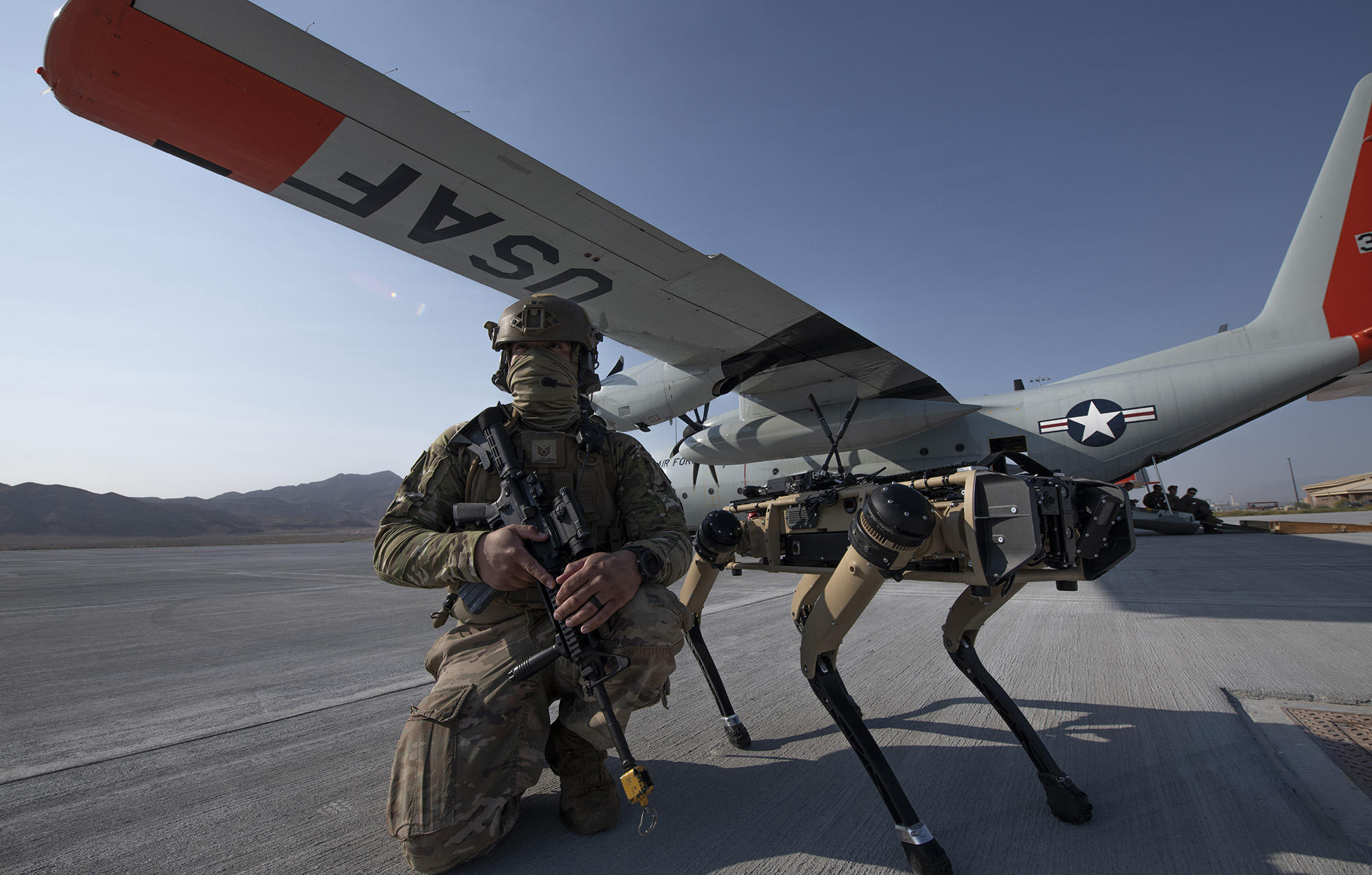 Tech. Sgt. John Rodiguez provides security with a Ghost Robotics Vision 60 prototype at a simulated austere base during the Advanced Battle Management System exercise on Nellis Air Force Base, Nev., Sept. 1, 2020. (Tech. Sgt. Cory D. Payne/Air Force)