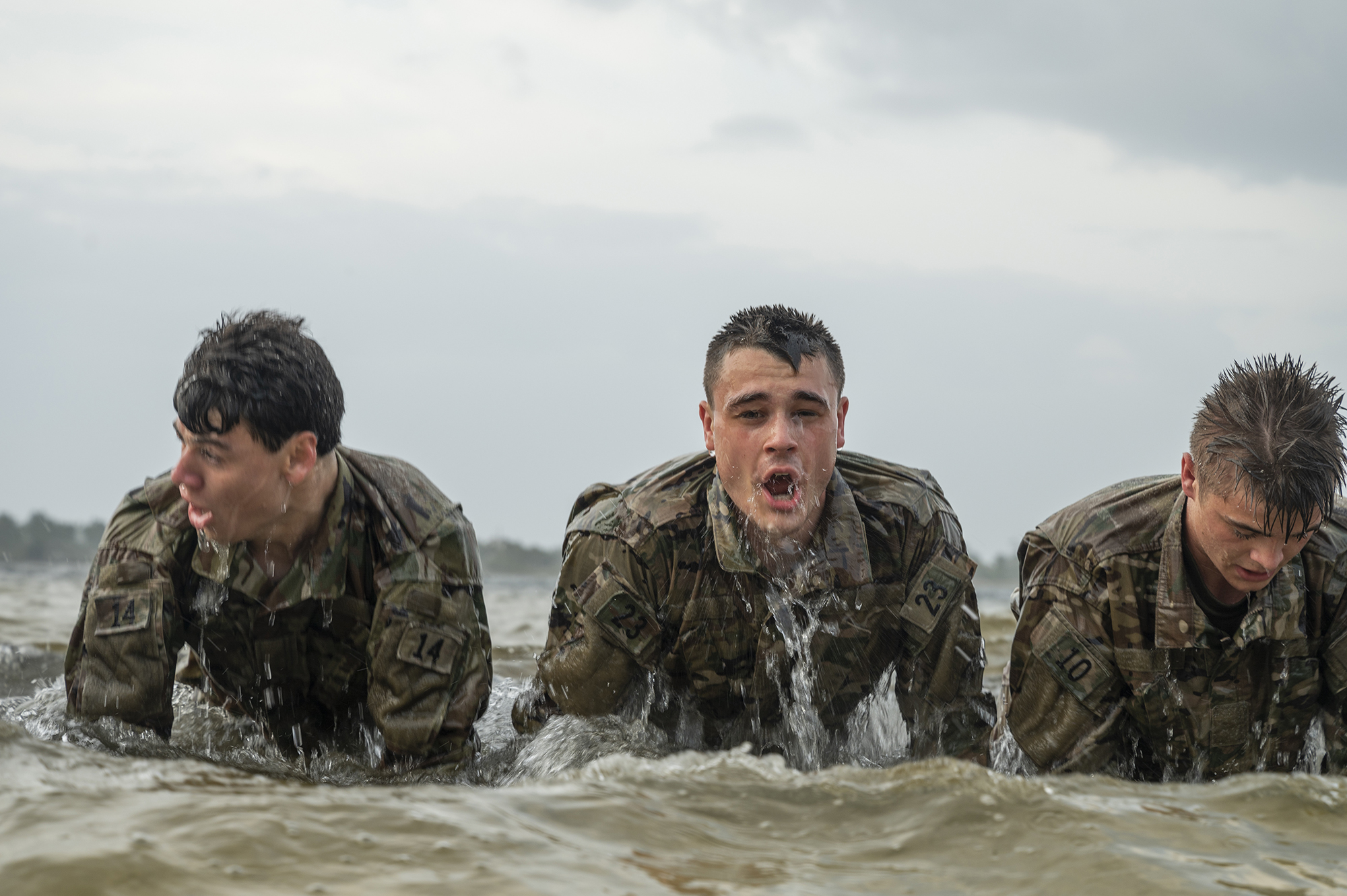 Air Force special tactics and combat rescue officer candidates perform push-ups in the water during an assessment and selection process at Hurlburt Field, Fla., March 25, 2021. (Tech. Sgt. Sandra Welch/Air Force)