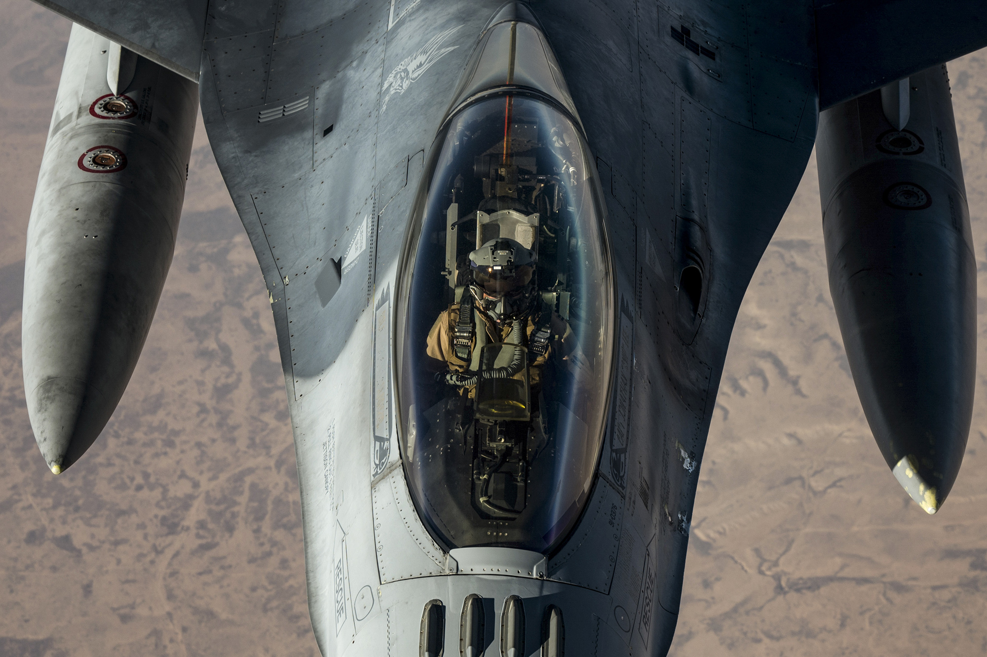 A U.S. Air Force KC-10 Extender conducts aerial refueling with an F-16 Fighting Falcon in the U.S. Central Command area of responsibility Nov. 30, 2020. (Staff Sgt. Sean Carnes/Air Force)