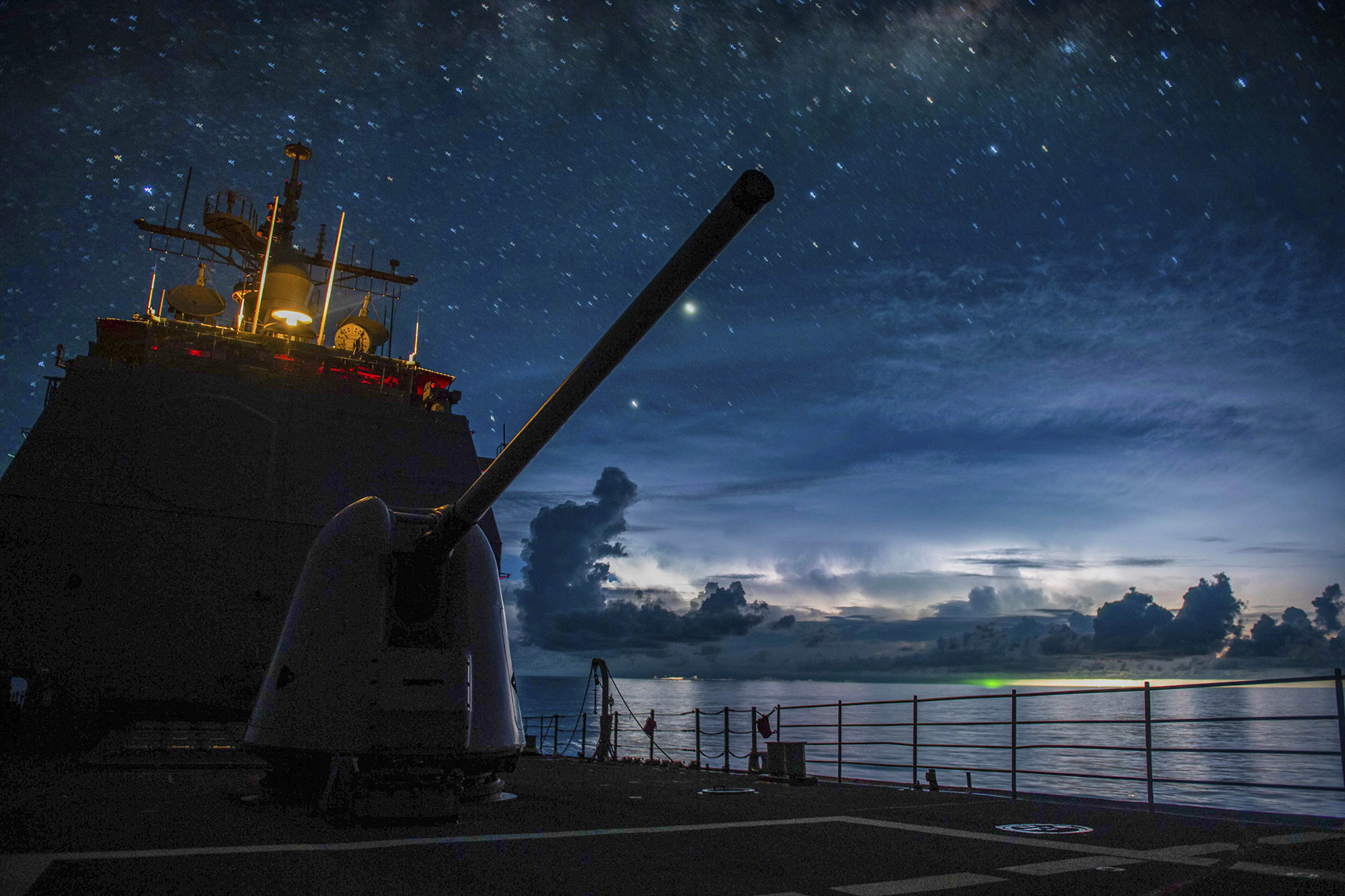 The Ticonderoga-class guided-missile cruiser USS Princeton (CG 59) steams through the night in the South China Sea on July 15, 2020. (MC2 Logan C. Kellums/Navy)