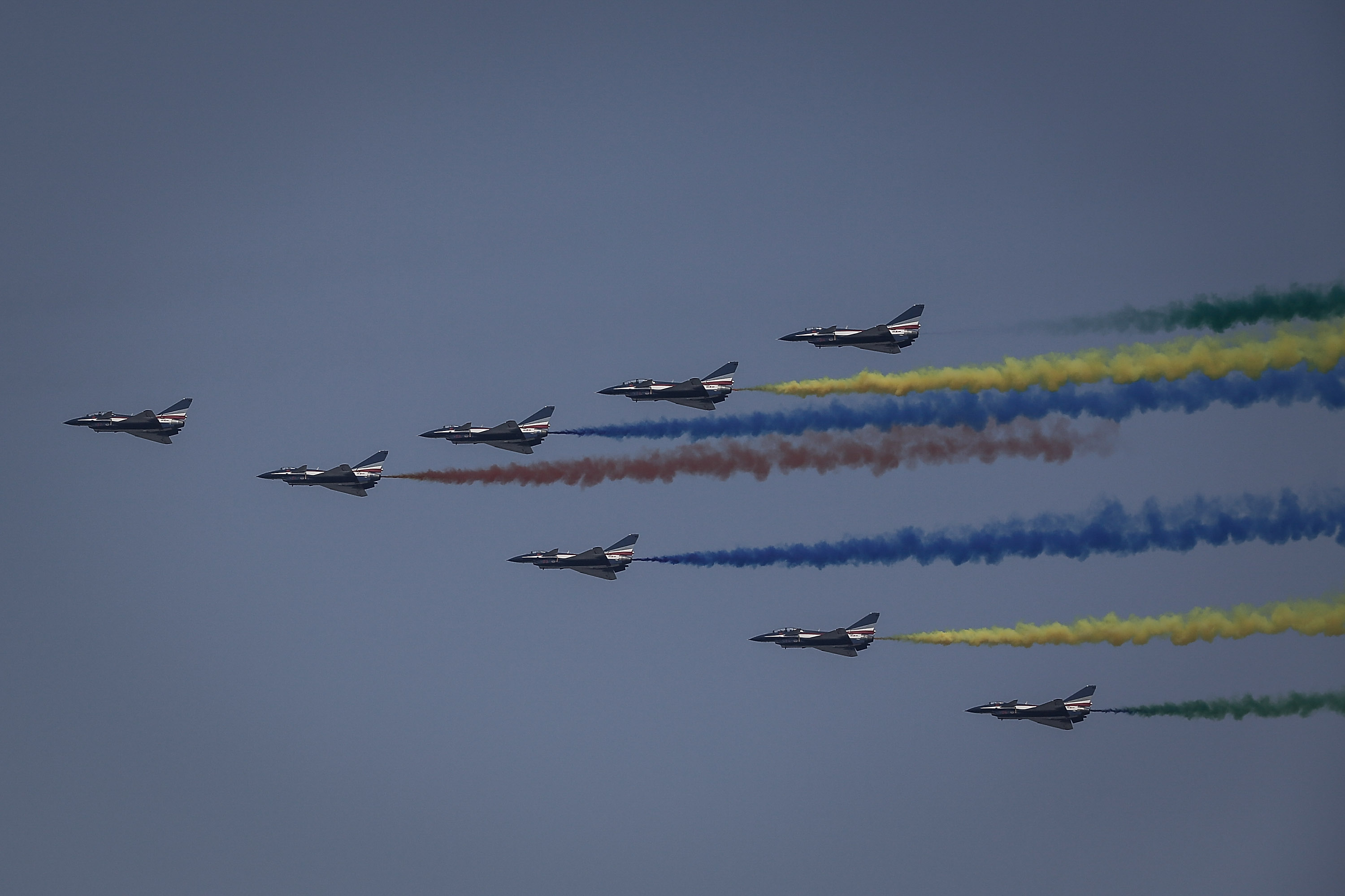 Planes from the Chinese People's Liberation Army Air Force fly in formation during a parade to celebrate the 70th anniversary of the founding of the People's Republic of China. (Wang He/Getty Images)
