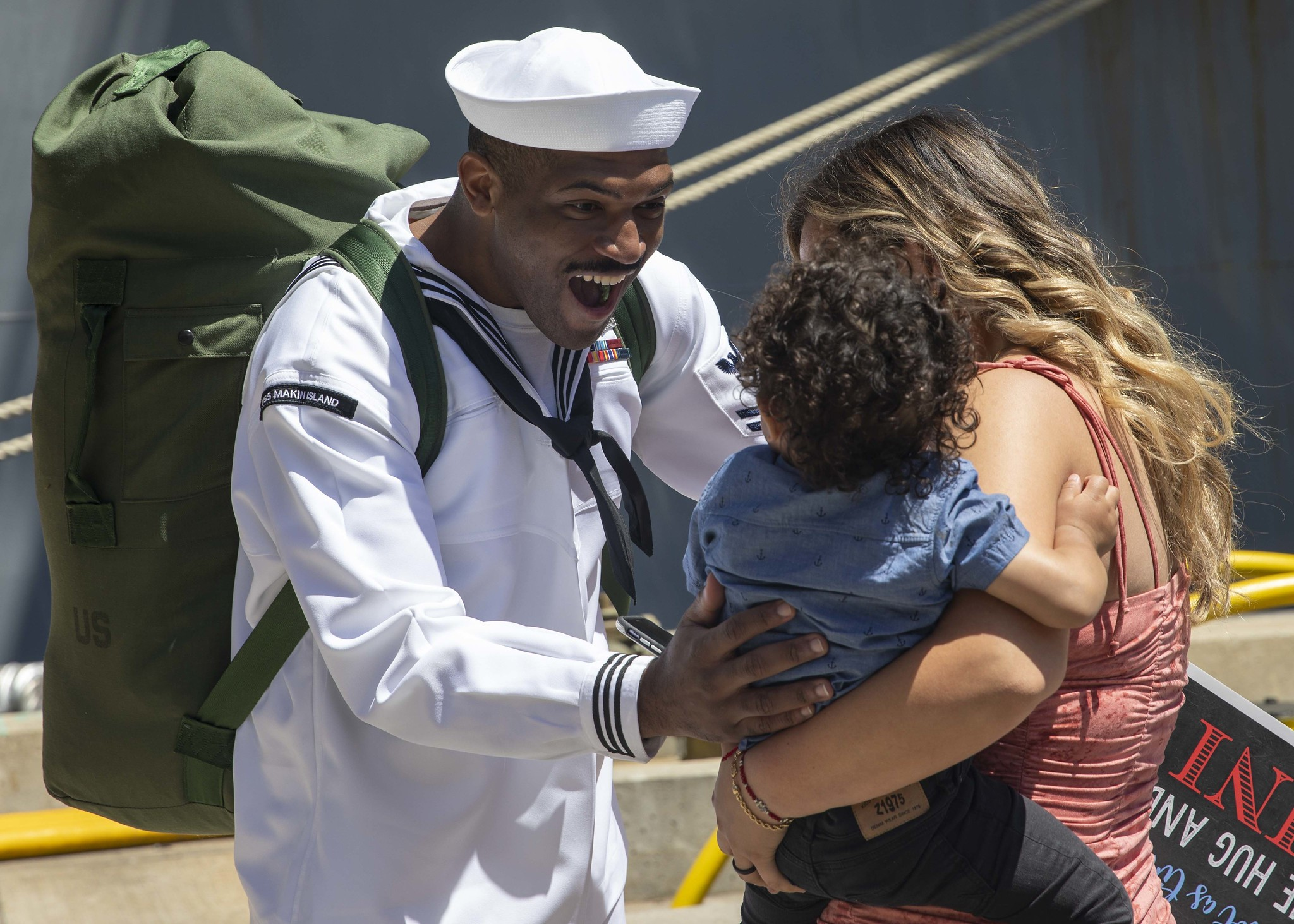 Cryptologic Technician (Collection) 1st Class Kameron Bradley greets his family on May 23, 2021, after returning to homeport from a seventh-month deployment aboard the amphibious transport dock ship USS Somerset (LPD 25) in San Diego, Calif. (MC2 Michael J. Lieberknecht/Navy)