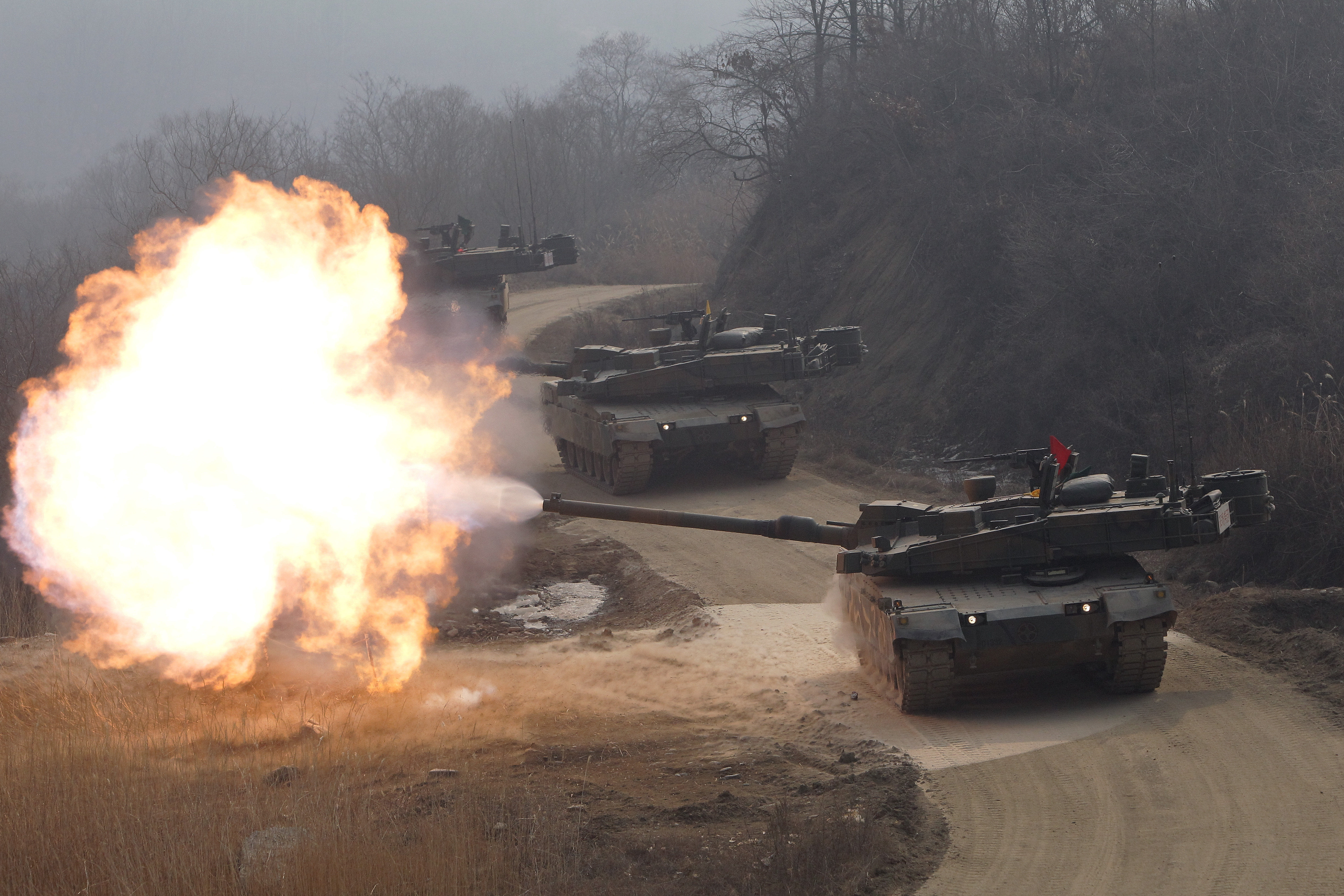 South Korean K2 tanks fire live rounds during a February 11, 2015, drill in Gyeonggi-do, South Korea. (Chung Sung-Jun/Getty Images)