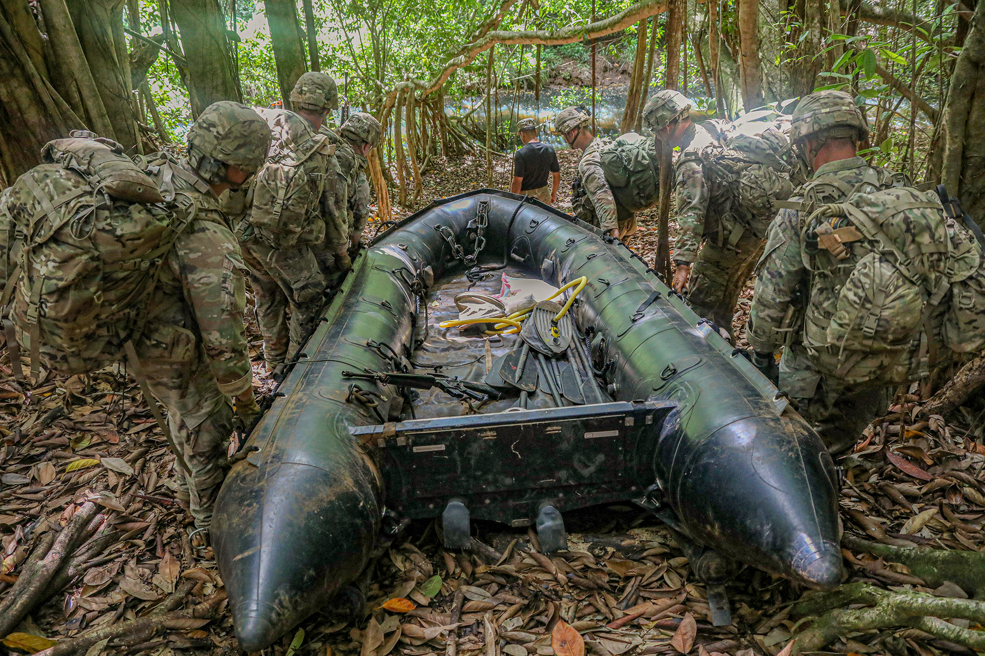 Soldiers assigned to the 25th Infantry Division conduct waterborne operations during patrol lanes at the Jungle Operations Training Course, Schofield Barracks East Range Training Complex, Hawaii, June 13, 2020. (Spc. Ezra Camarena/Army)