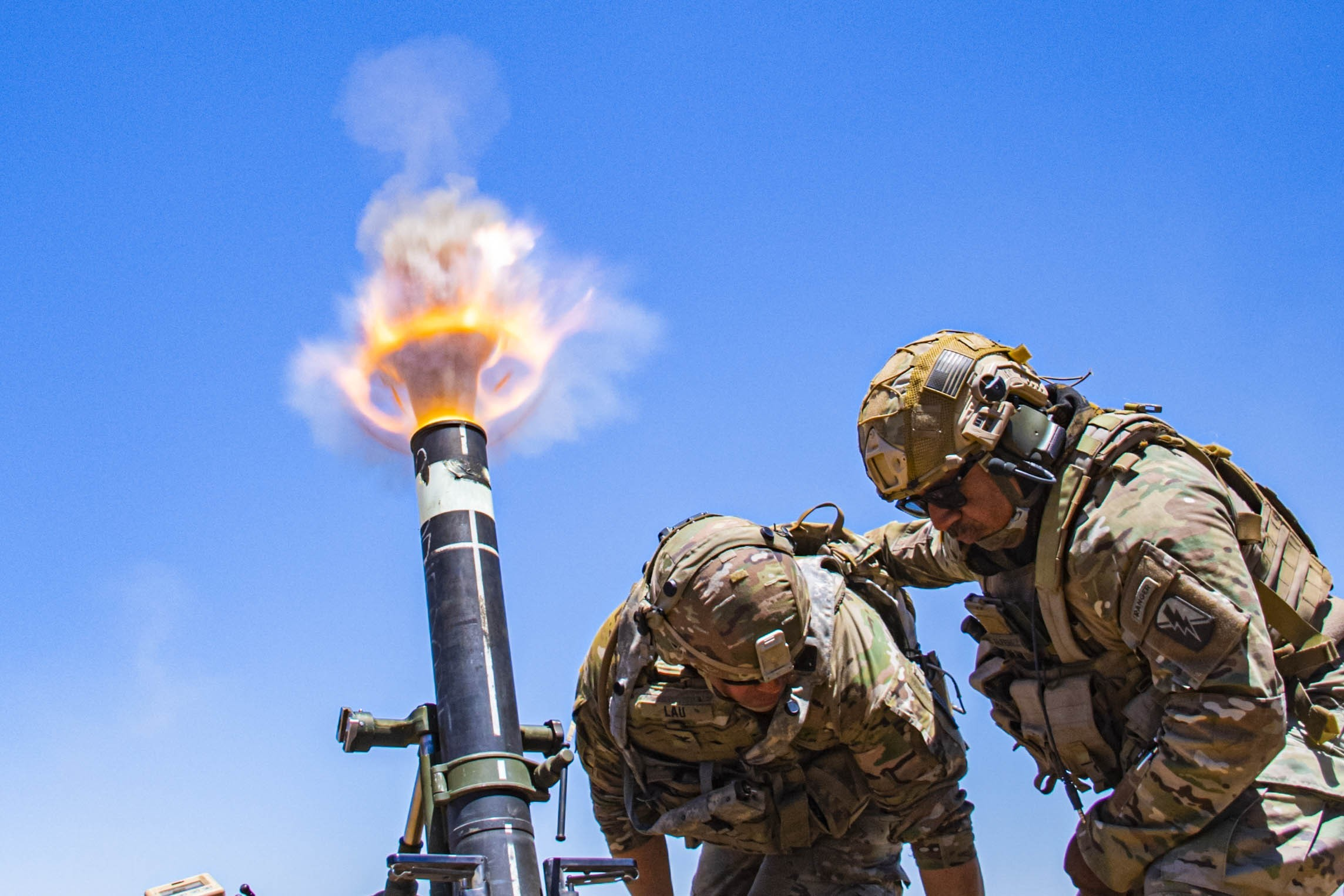 Army Col. Randy Lau fires a 120 mm mortar during a live-fire exercise at Camp Roberts, Calif., June 15. (Staff Sgt. Walter Lowell/Army)