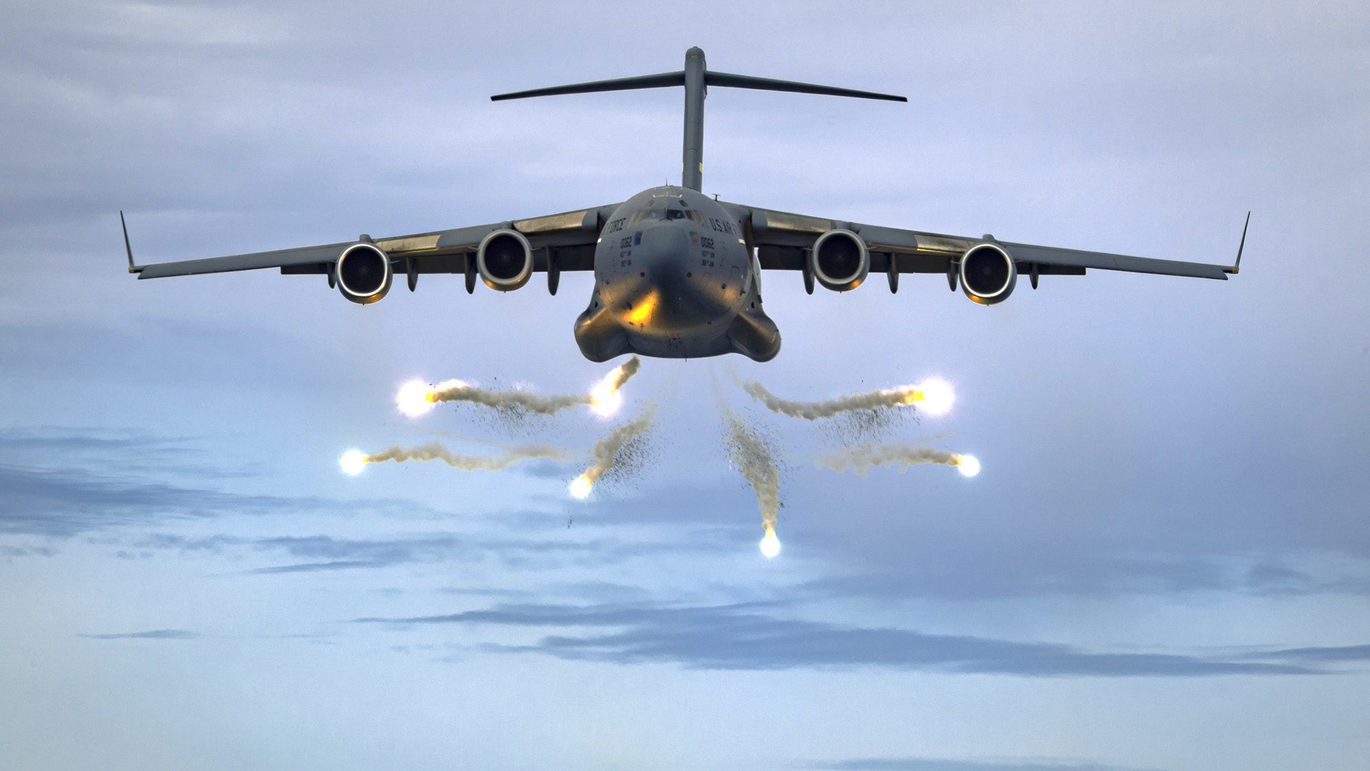 A C-17 Globemaster III deploys flares as part of a training event over the Atlantic Ocean in a military operating area outside Charleston, S.C., June 5, 2021. (Tech. Sgt. Chris Hibben/Air Force)