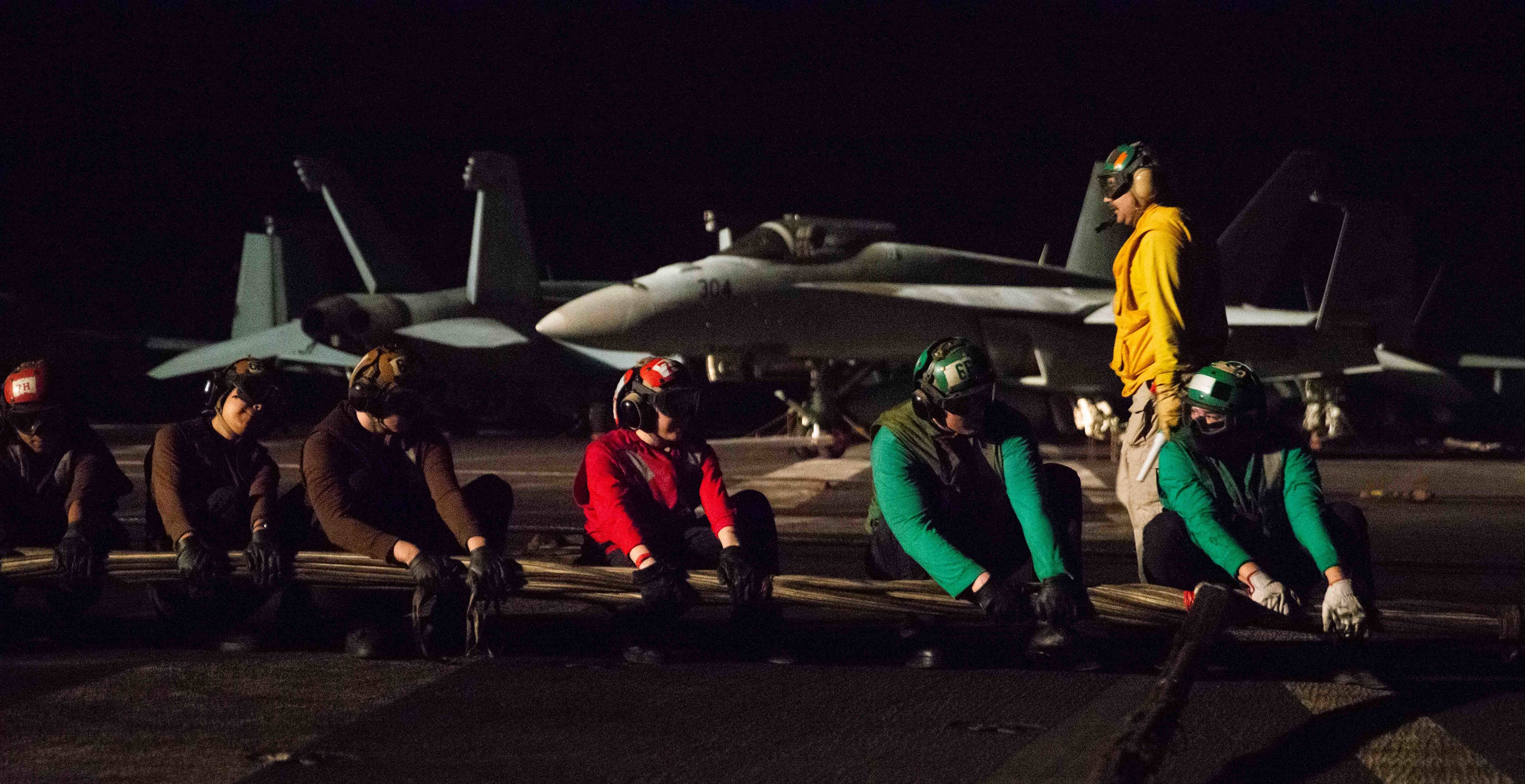 Sailors set up a barricade on the flight deck of the aircraft carrier Ronald Reagan during a damage control drill in the Gulf of Aden July 13. The Reagan is deployed to U.S. 5th Fleet to ensure maritime stability and security in the Central Command region. (MCSN Gray Gibson/Navy)