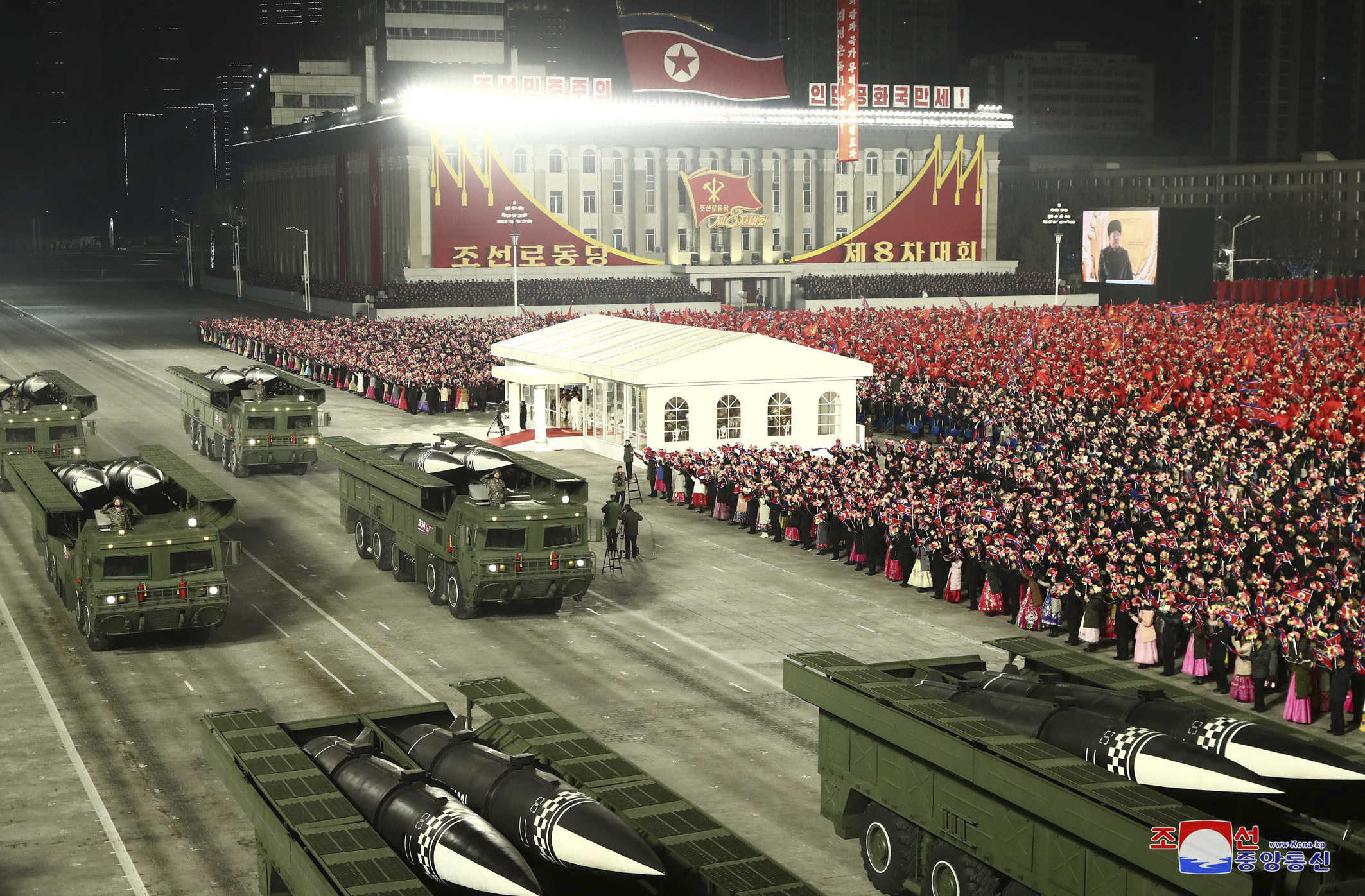 Missiles are seen on trucks during a military parade in Pyongyang, North Korea, on Jan. 14, 2021. (Korean Central News Agency/Korea News Service via AP)