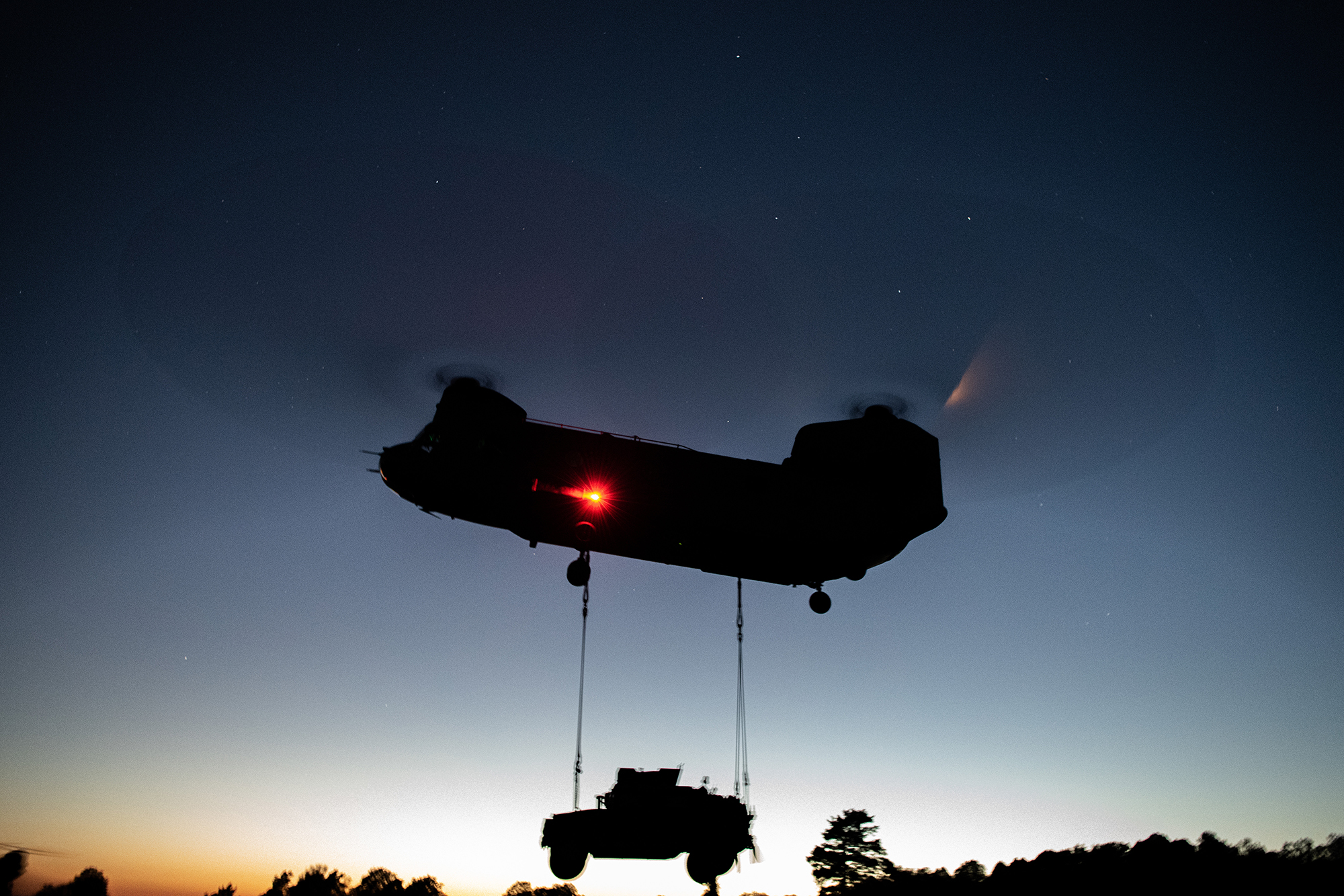 U.S. Army paratroopers perform night sling operations with a CH-47 Chinook in preparation for Exercise Saber Junction 20 on Aug. 5, 2020, as part of the 173rd Brigade Field Training Exercise in Grafenwoehr Training Area, Germany. (Sgt. John Yountz/Army)