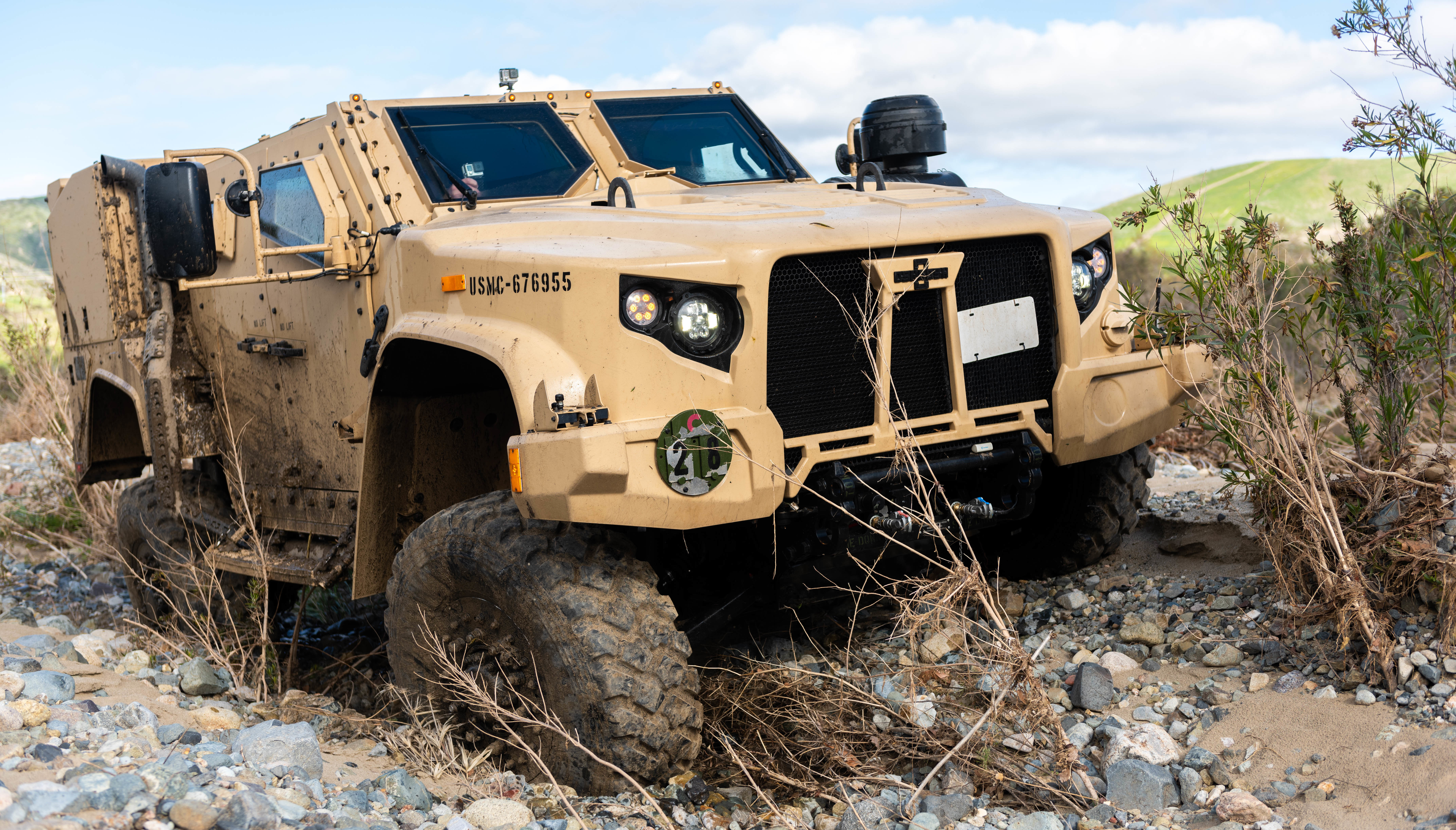 A Joint Light Tactical Vehicle displays its ability to handle multiple terrain types by physically adjusting its suspension during a demonstration at the School of Infantry West, Marine Corps Base Camp Pendleton, California. (Sgt. Timothy R. Smithers/Marine Corps)