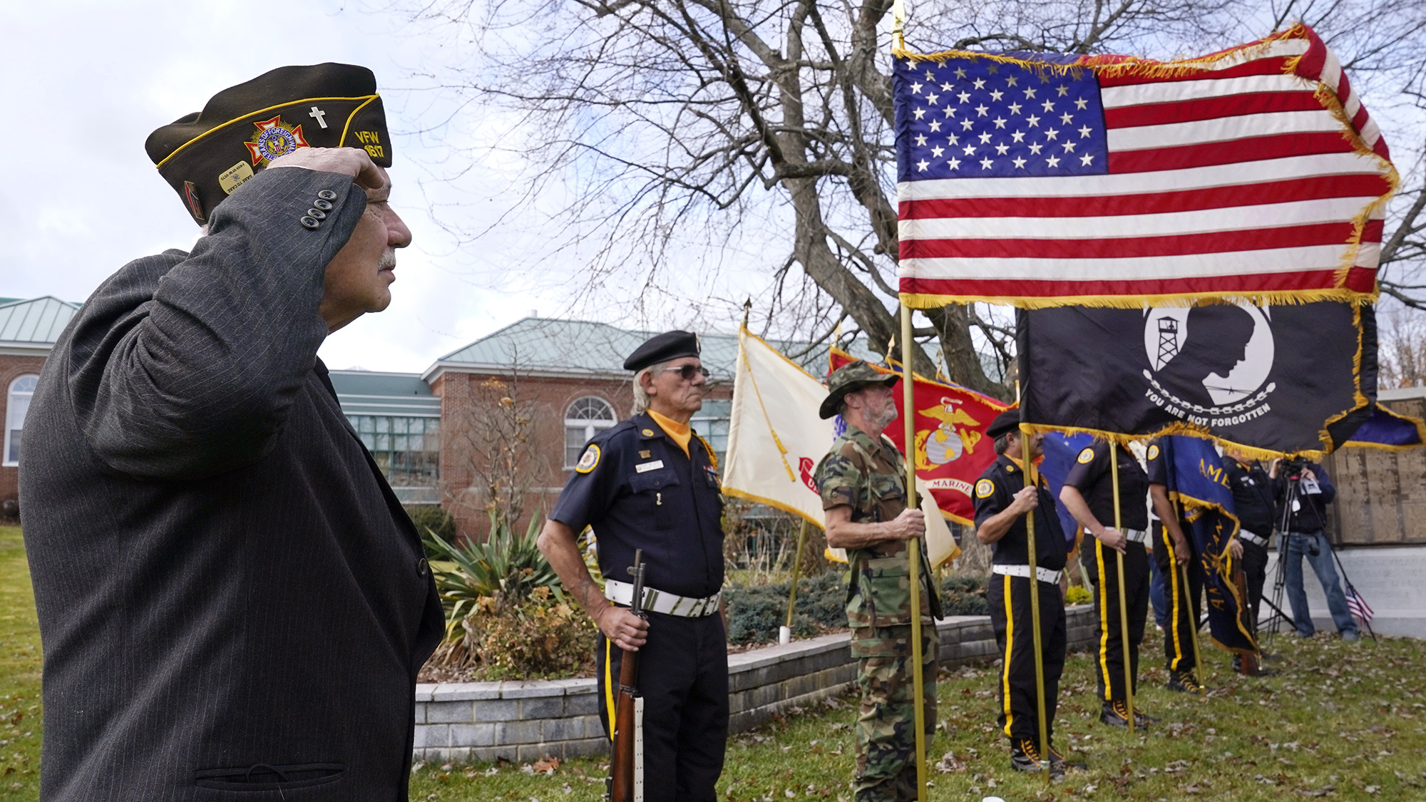 Chaplain Charles Andriolo, of VFW Post 1617, salutes during a Veterans Day ceremony, Wednesday, Nov. 11, 2020, in Derry, N.H. (Charles Krupa/AP)
