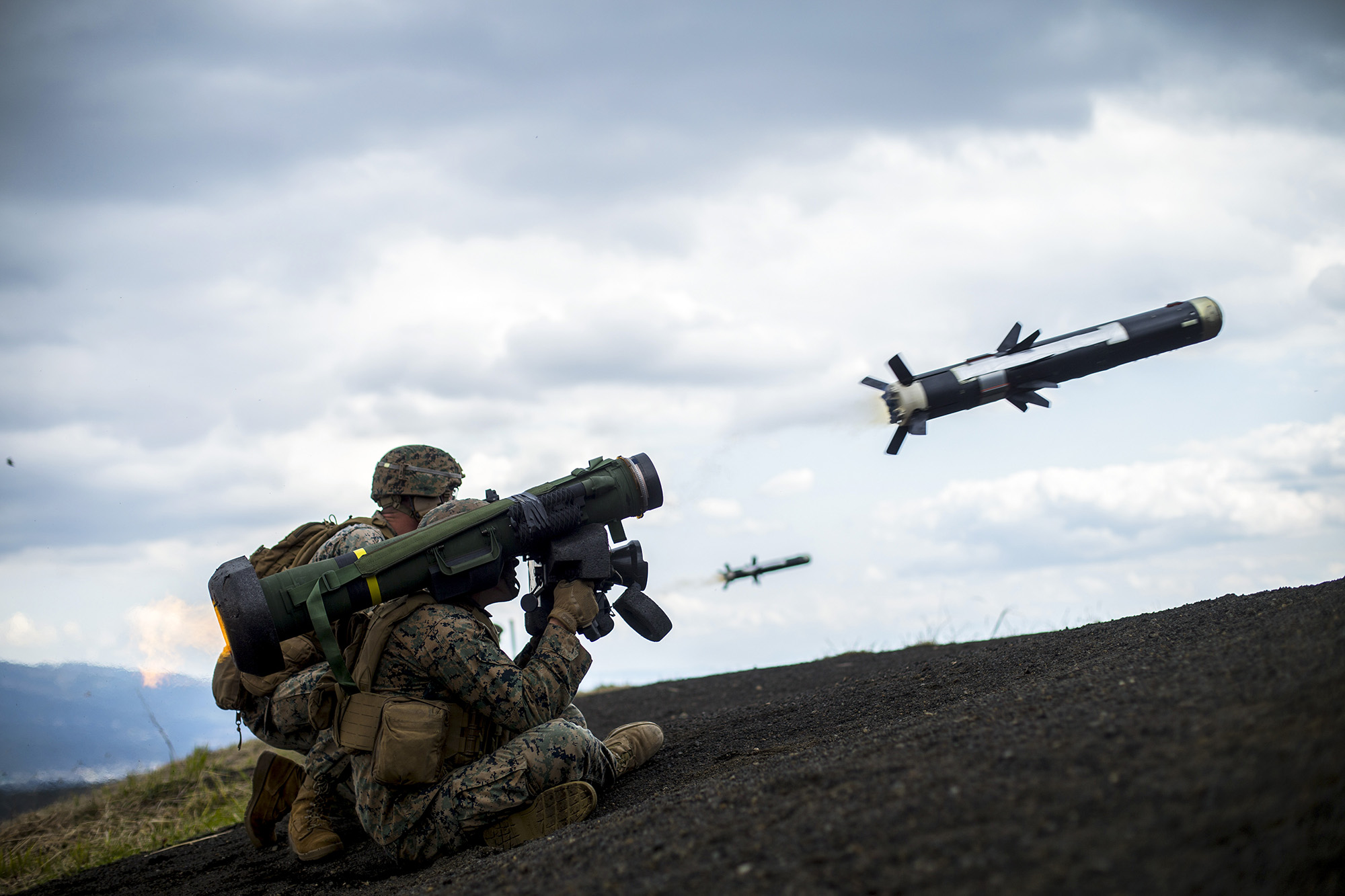 U.S. Marine Corps Lance Cpl. Justin Cooper and Cpl. Jacob Siemsen fire a Javelin missile while conducting a live-fire combat rehearsal during Fuji Viper 21.3 at Combined Arms Training Center, Camp Fuji, Japan, April 12, 2021. (Lance Cpl. Jonathan Willcox/Marine Corps)