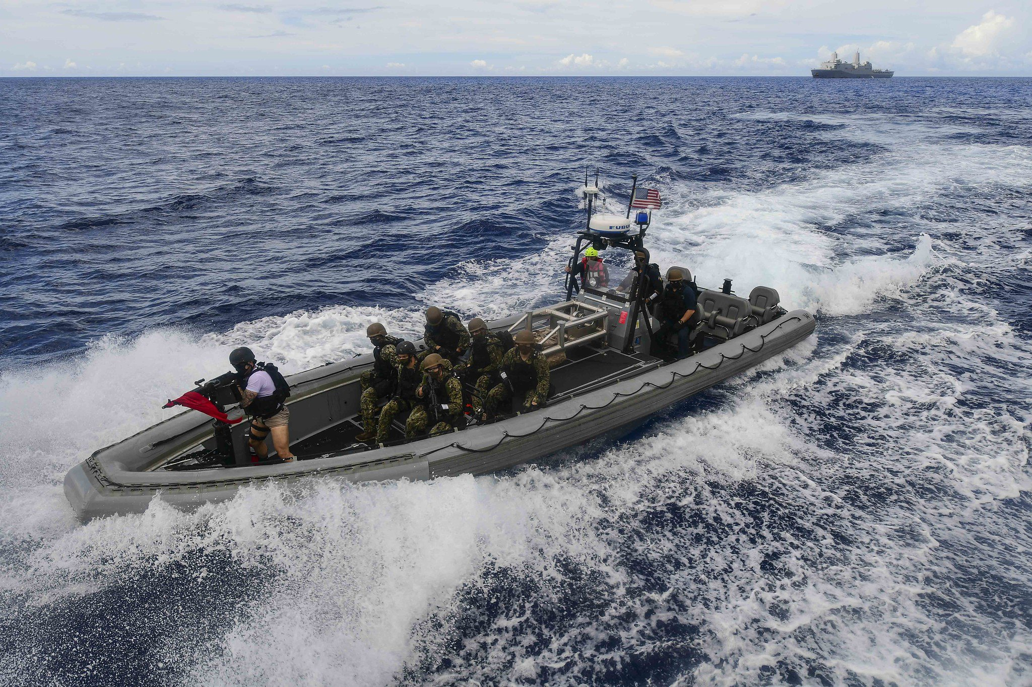 A visit, board, search and seizure team from the amphibious transport dock ship USS New Orleans (LPD 18) approaches a simulated suspect vessel during a training exercise Sept. 16, 2020, in the Philippine Sea. (MC2 Kelby Sanders/Navy)