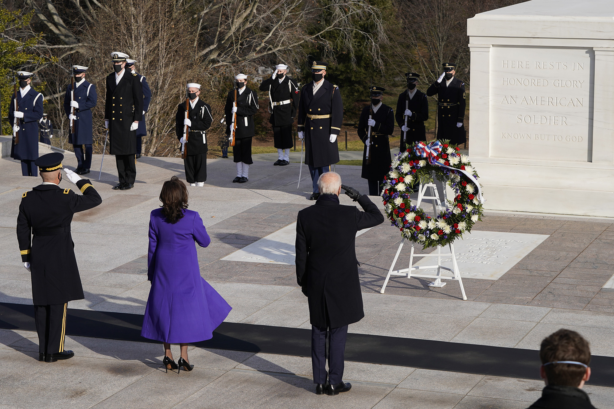 President Joe Biden, center, Vice President Kamala Harris, and Maj. Gen. Omar J. Jones salute at the Tomb of the Unknown Soldier at the Arlington National Cemetery on Jan. 20, 2021, in Arlington, Va. (Joshua Roberts-Pool/Getty Images)