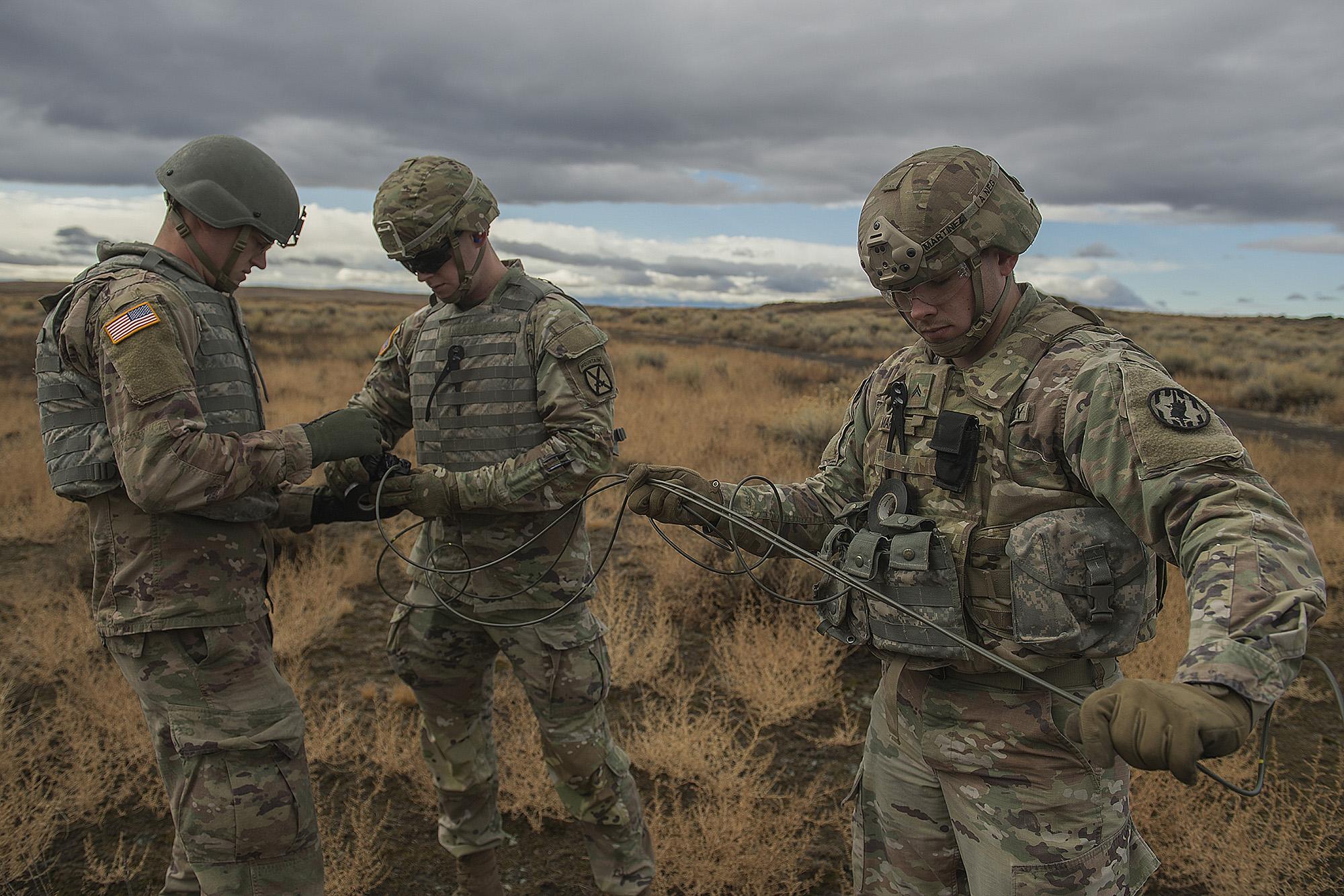 Army Spcs. Timothy Martin, left, and Shane Flores, middle, and Cpl. Dario Martinez prepare for a detonation during training in Boise, Idaho, Nov. 18, 2020. (Thomas Alvarez/Army)