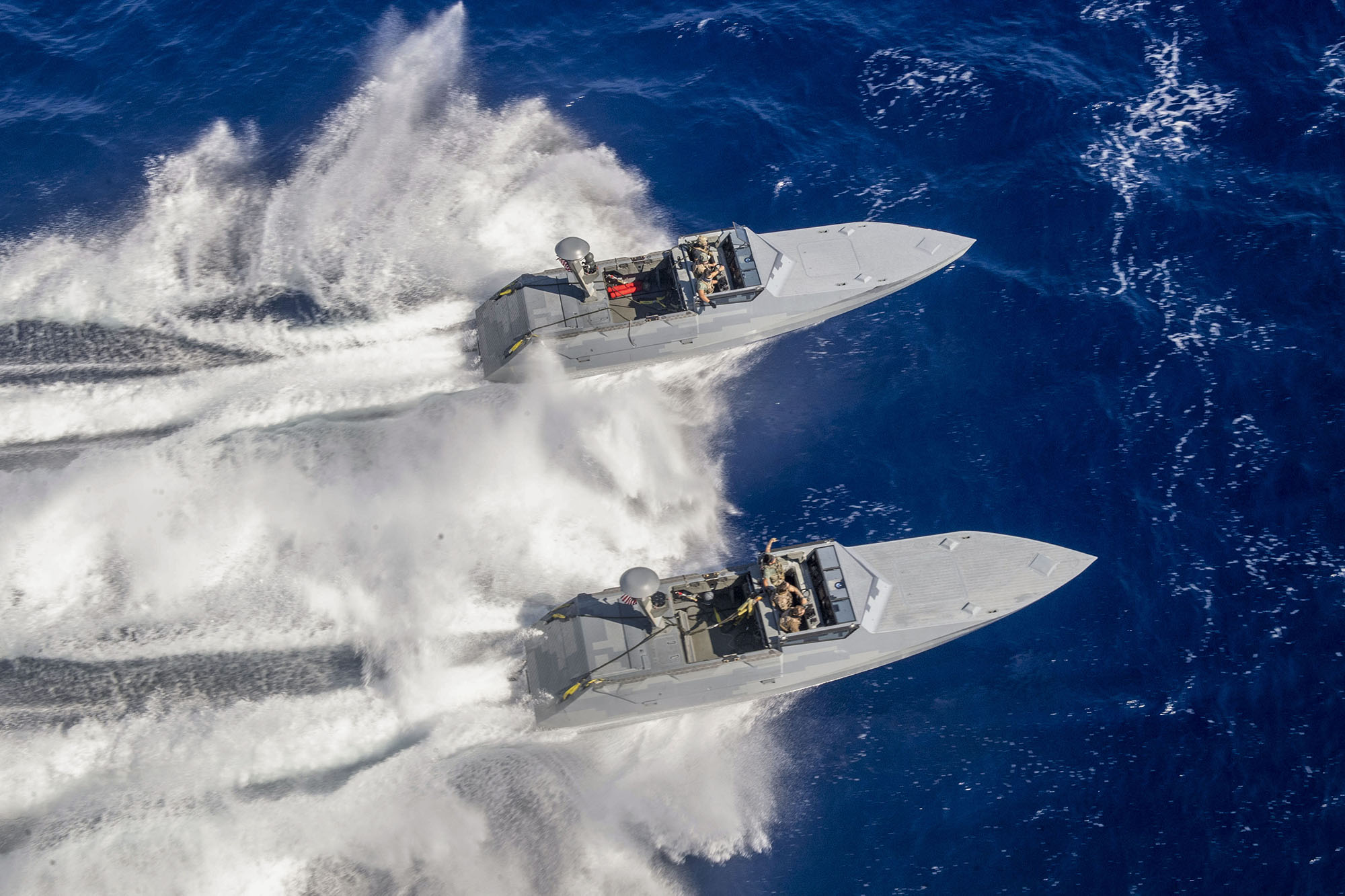 Sailors on combat craft assault (CCA) conduct small boat operations with the Expeditionary Sea Base USS Hershel