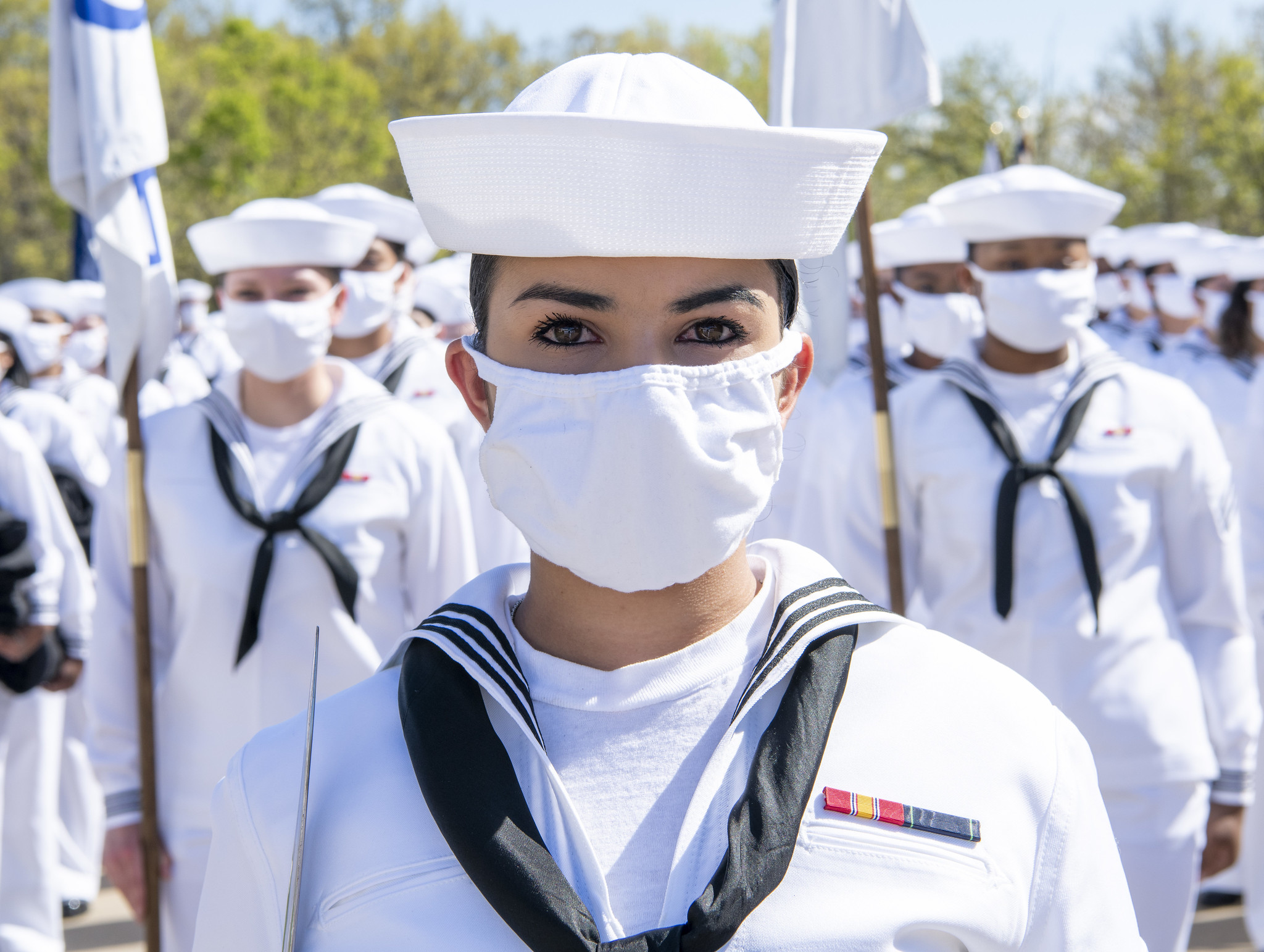 A recruit chief petty officer stands at the lead of her formation May 13, 2021, before there pass-in-review graduations ceremony at Recruit Training Command at Great Lakes, Ill. (MC1 Spencer Fling/Navy)