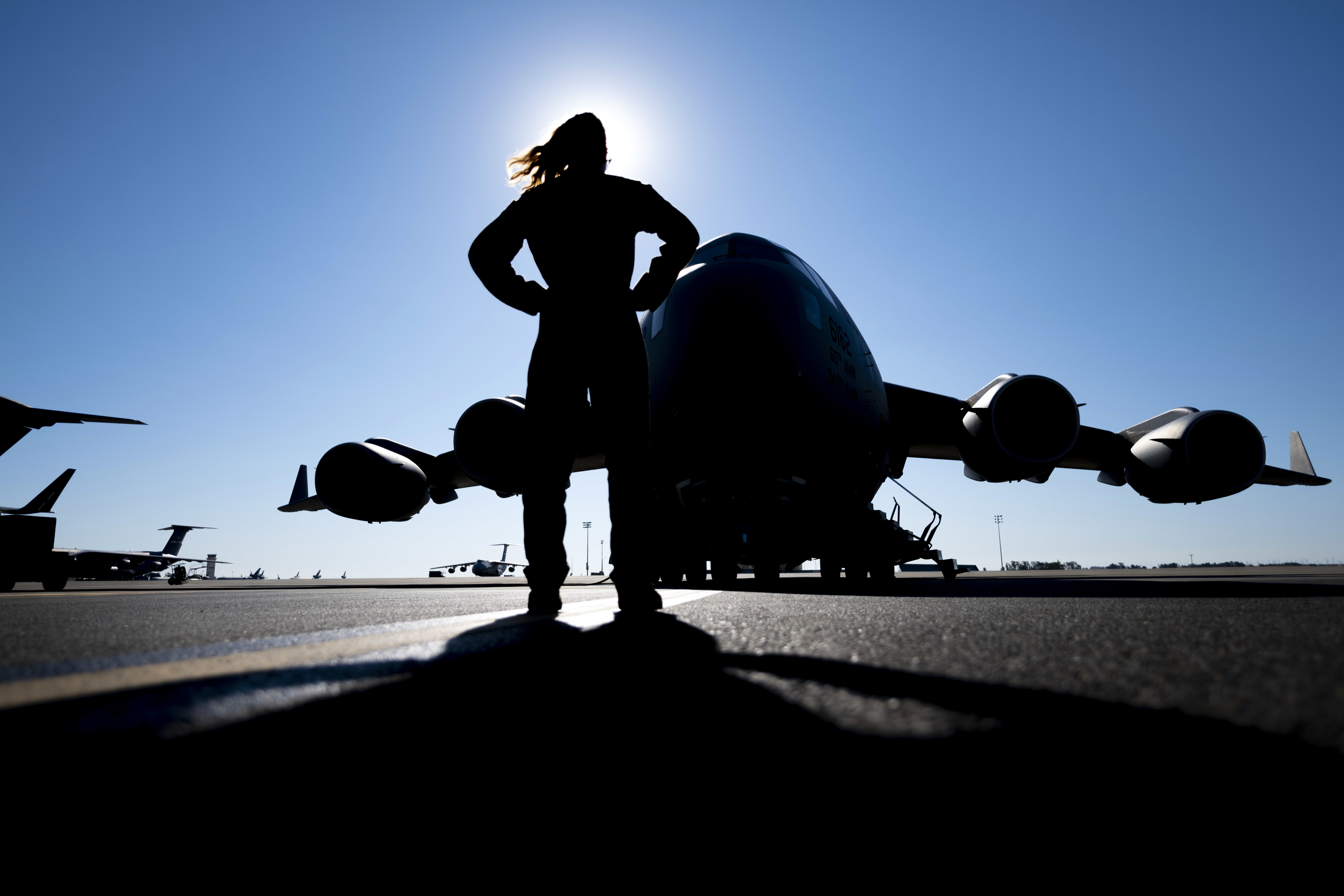 Senior Airman Sara Marinelli, a loadmaster with the 21st Airlift Squadron, stands in front of a C-17 Globemaster III July 6 at Travis Air Force Base, California. The 21st AS conducted a training mission that enabled qualification currency for seven crew members. (Senior Airman Jonathon Carnell/Air Force)