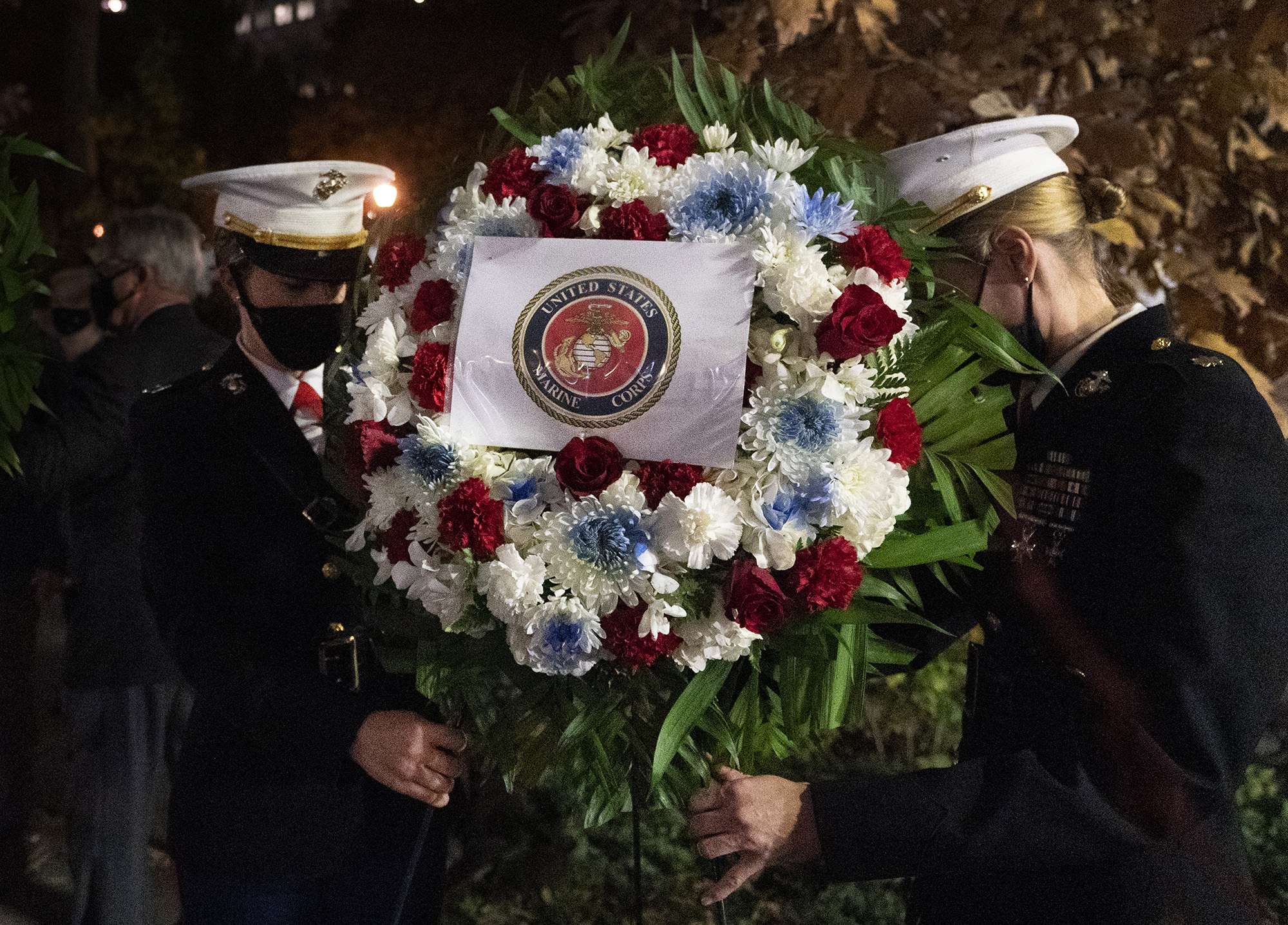 A Navy and Marine Corps honor guard lays a wreath at the Eternal Light Flagstaff in Madison Square Park, Wednesday, Nov. 11, 2020, in New York. The ceremony preceded a quiet 100-vehicle Veterans Day parade, with no spectators, to maintain the 101-year tradition of veterans marching on Fifth Avenue. (Mark Lennihan/AP)