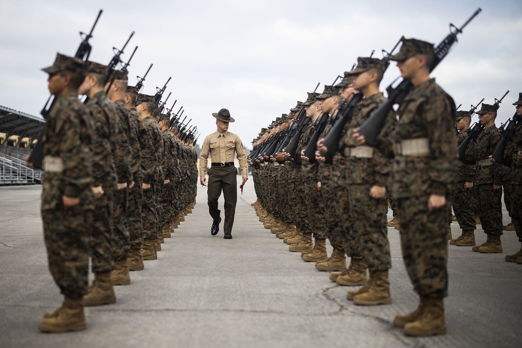 Staff Sgt. Andrew Snyder evaluates recruits with Charlie Company, 1st Recruit Training Battalion during their final drill evaluation at Marine Corps Recruit Depot, San Diego, Dec. 14, 2019. (Zachary T. Beatty/Marine Corps)