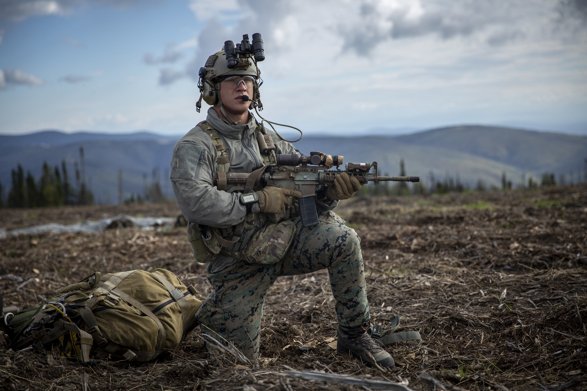 Hospital Corpsman 3rd Class Wayne Jaworski provides security after completing a free-fall insert during a Marine Corps combat readiness evaluation at Eielson Air Force Base, Alaska, Aug. 21, 2020. (Cpl. Israel Chincio/Marine Corps)