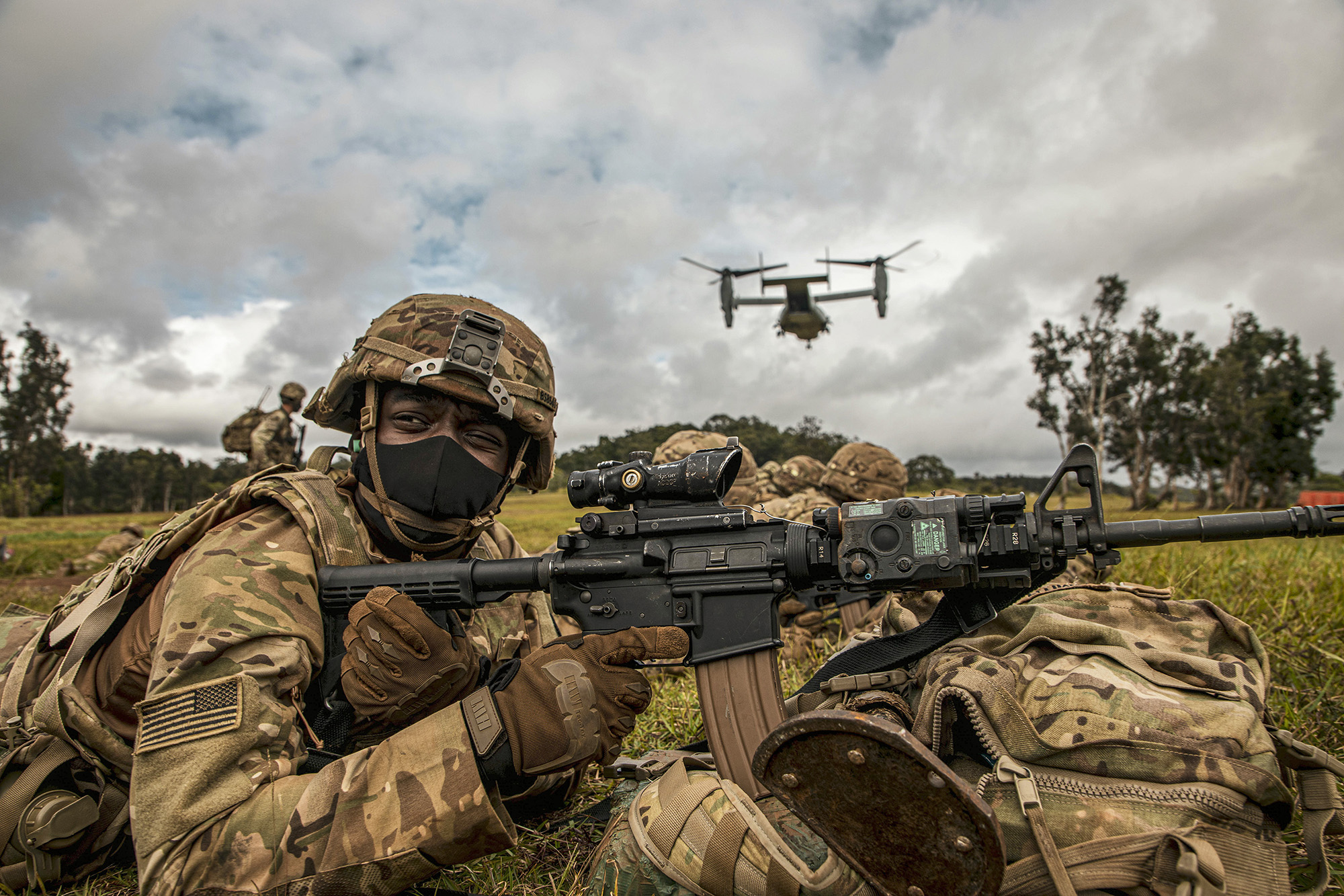 A service member participates in an exercise called Operation Wardog Kila for a joint live-fire exercise at Schofield Barracks, Hawaii, Dec. 30, 2020, with the 25th Combat Aviation Brigade, 25th Infantry Division Artillery units and the U.S. Marine Corps. (Sgt. Sarah D. Sangster/Army)