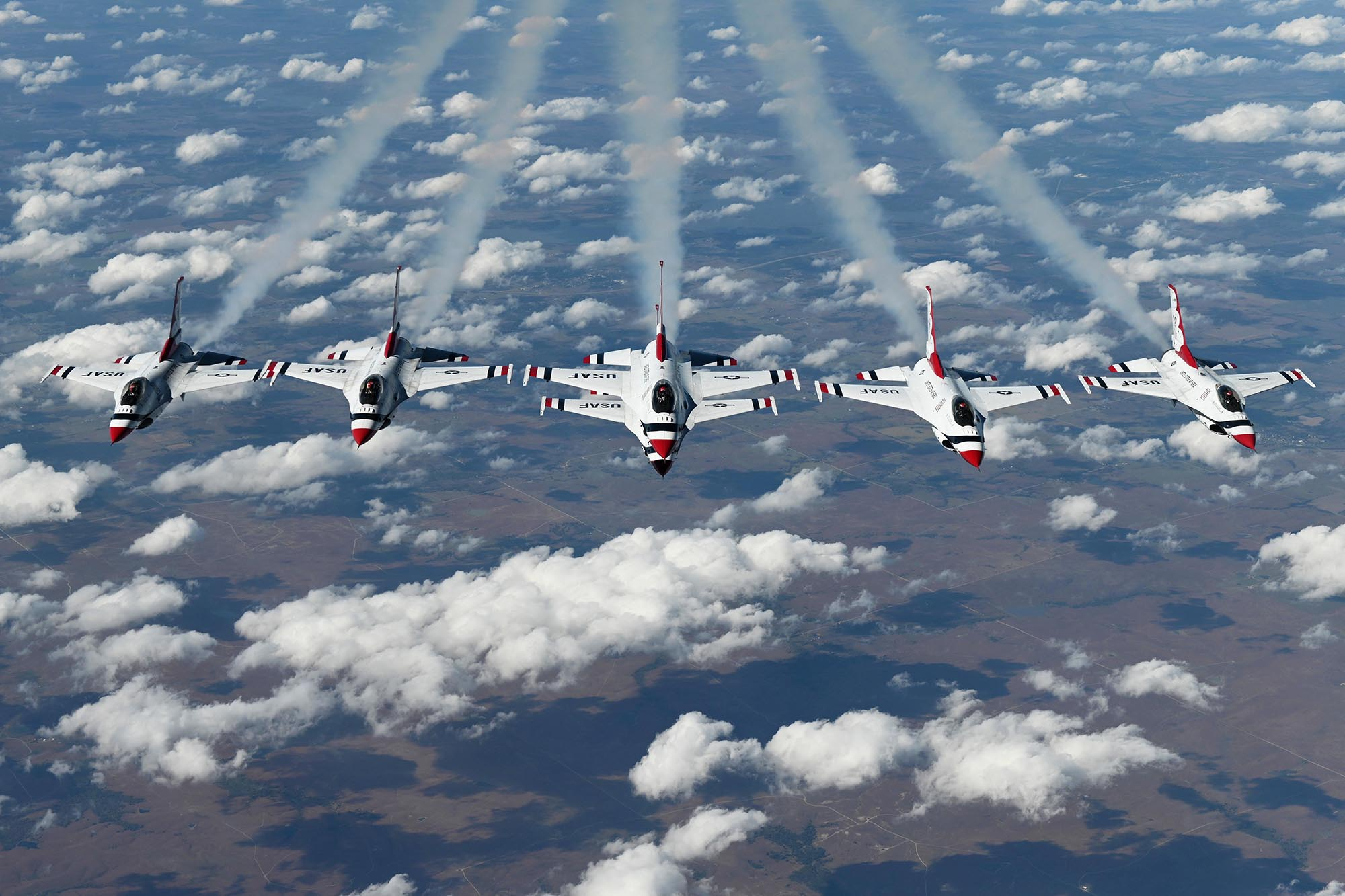 The U.S. Air Force Thunderbirds perform a six-ship formation under a KC-10 Extender, Oct. 22, 2020, over Oklahoma. (Senior Airman Jonathon Carnell/Air Force)