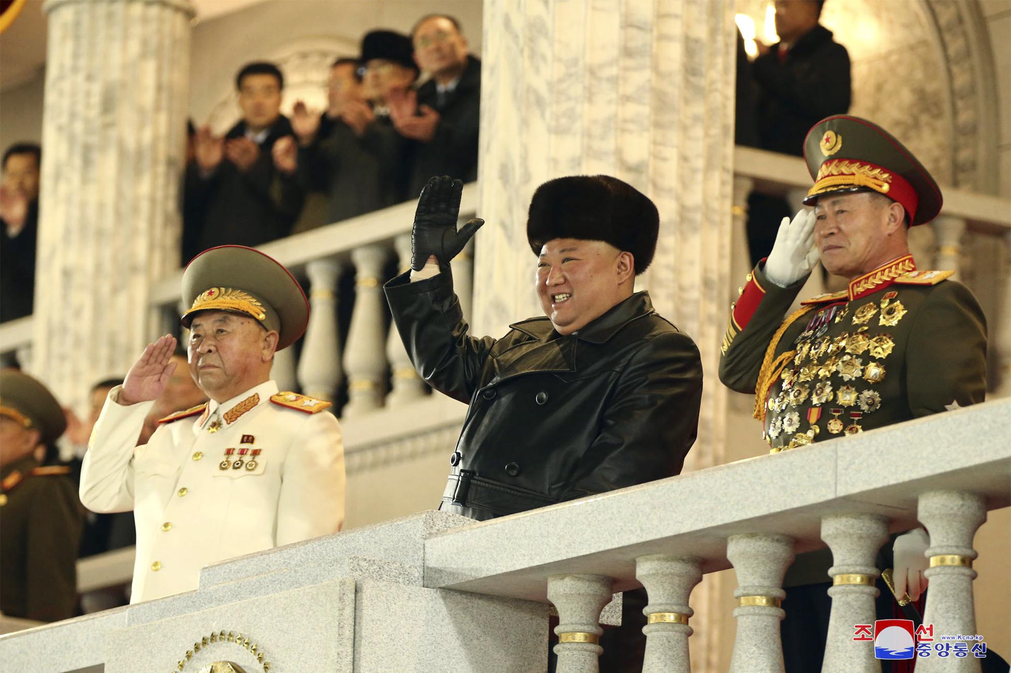 North Korean leader Kim Jong Un waves during a military parade in Pyongyang North Korea on Jan. 14 2021