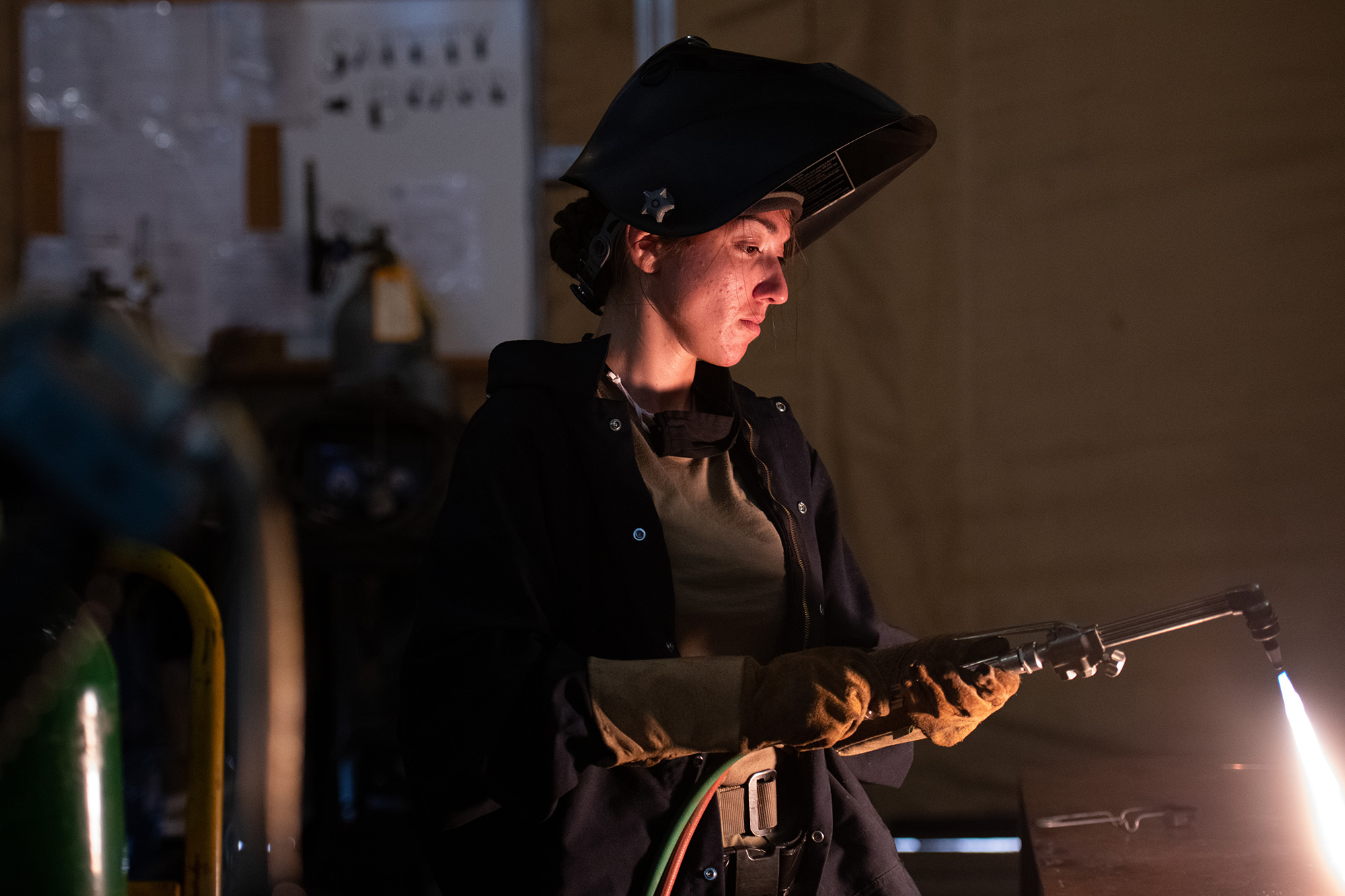 Staff Sgt. Natalie Delgado, an aircraft metals technician deployed to the 332d Air Expeditionary Wing, lights a torch preparing to cut metal on Sept. 24, 2020, in an undisclosed location. (Master Sgt. Jonathan Young/Air National Guard)