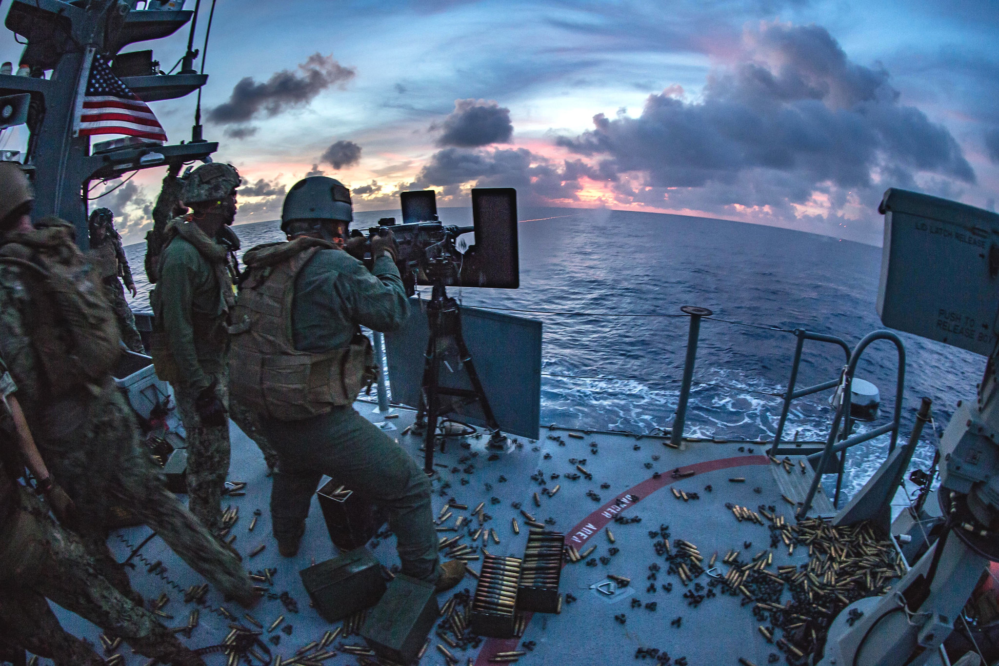 A sailor fires an M2 .50-caliber machine gun on a Mark VI patrol boat during a live-fire exercise in the Philippine Sea, Feb. 27, 2021. (Lance Cpl. Brienna Tuck/Marine Corps)