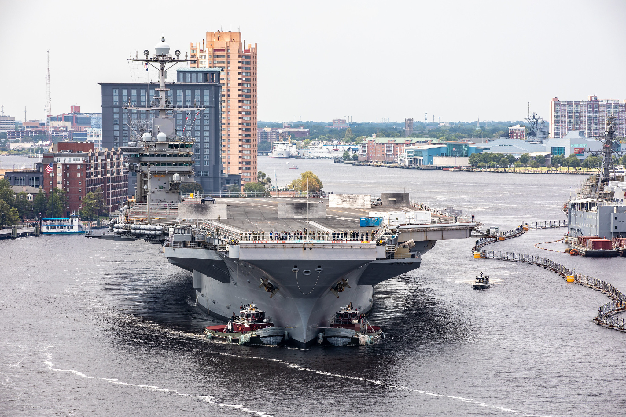 The aircraft carrier USS Harry S. Truman (CVN 75) arrives at Norfolk Naval Shipyard in Portsmouth, Va., July 7, 2020, for an extended carrier incremental availability. (Shelby West/Navy)