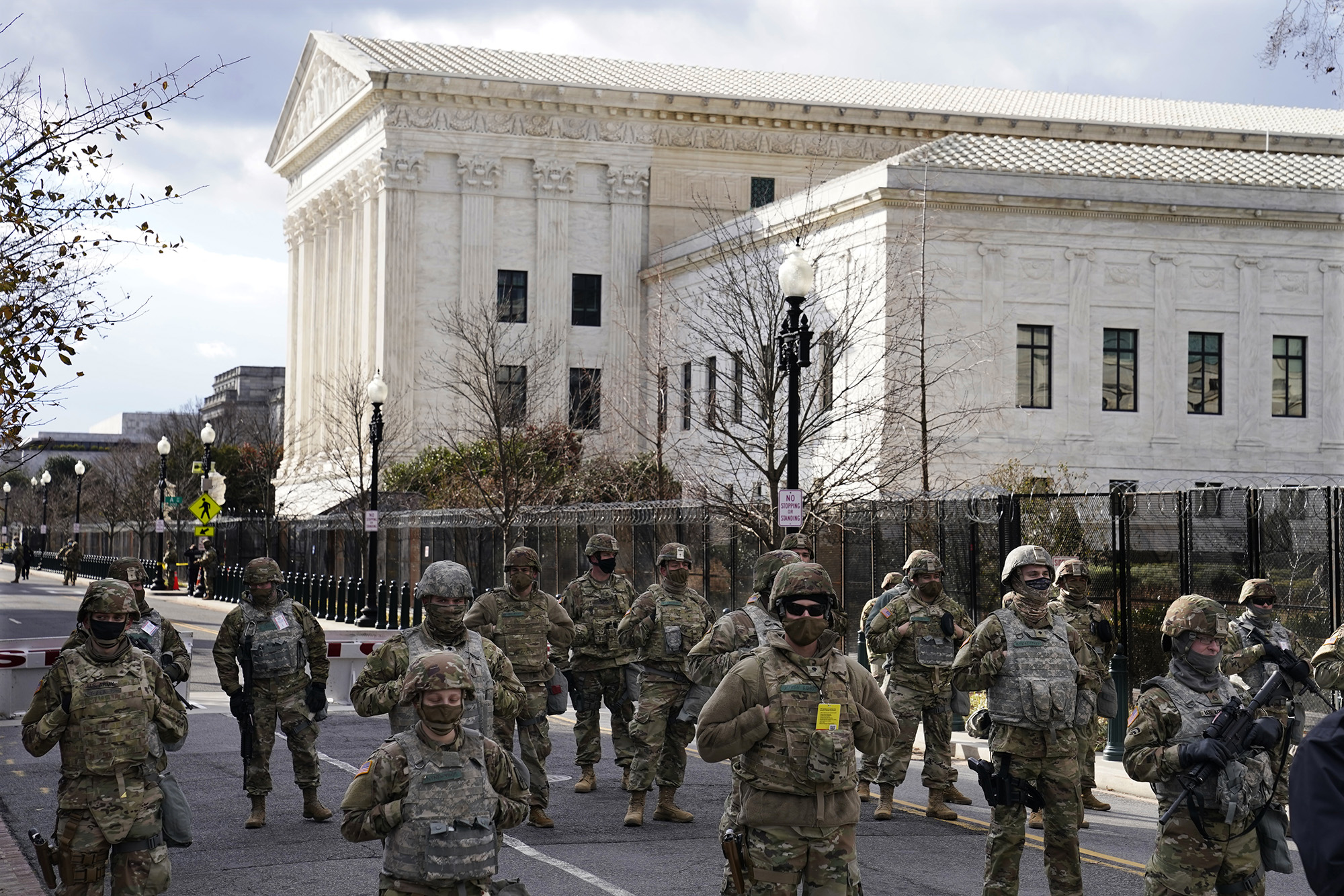 Members of the National Guard stand at a road block near the Supreme Court ahead of President-elect Joe Biden's inauguration ceremony, Wednesday, Jan. 20, 2021, in Washington. (John Minchillo/AP)