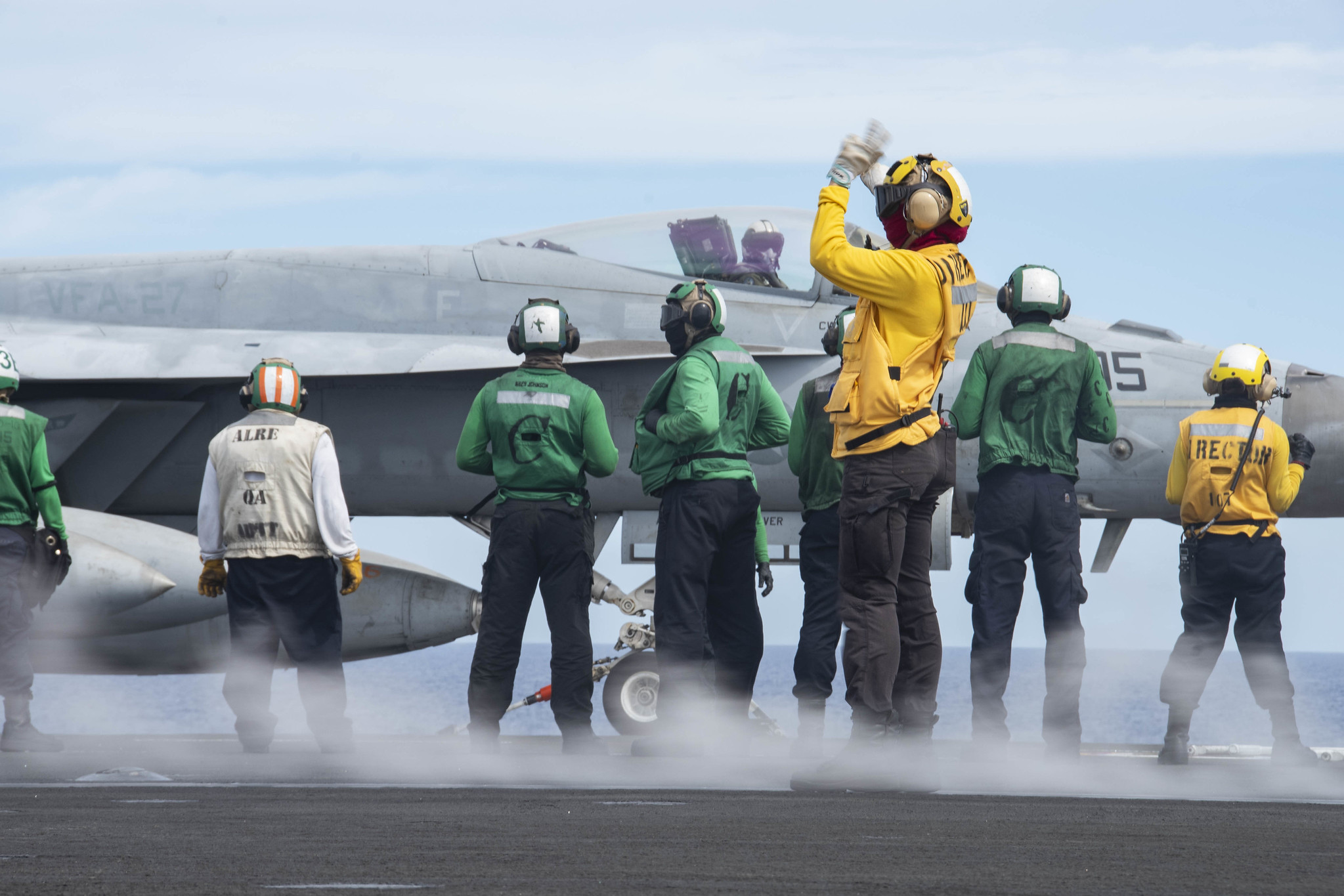 Sailors prepare to launch an F/A-18E Super Hornet on the flight deck of the aircraft carrier USS Ronald Reagan (CVN 76) on June 18, 2020, during flight operations in the Philippine Sea. (MC3 Erica Bechard/Navy)