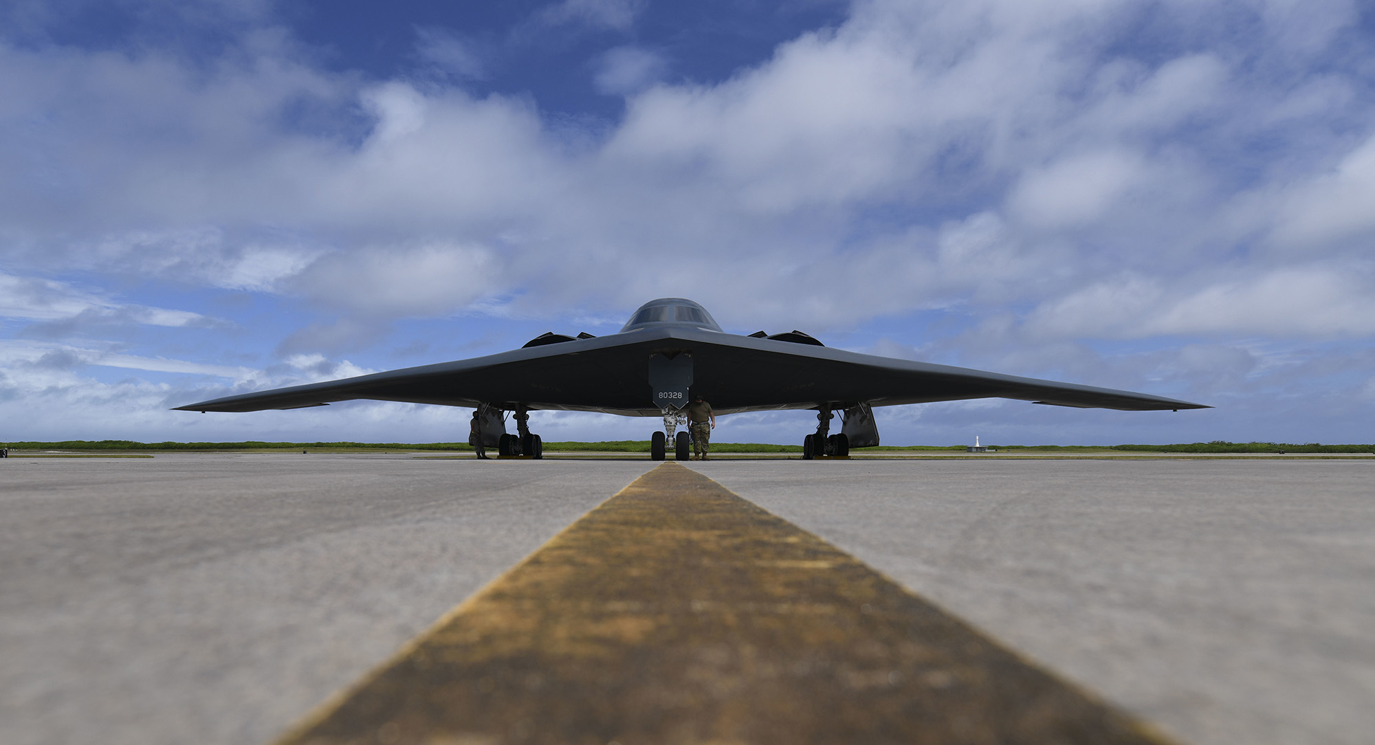 Senior Airman Robert Witkowski and Staff Sgt. Mark Farrar, 393rd Expeditionary Bomb Squadron crew chiefs, deployed from Whiteman Air Force Base, Mo., prepare a B-2 Spirit for takeoff at Naval Support Facility Diego Garcia in support of a Bomber Task Force mission, Aug. 17, 2020. (Tech. Sgt. Heather Salaza/Air Force)