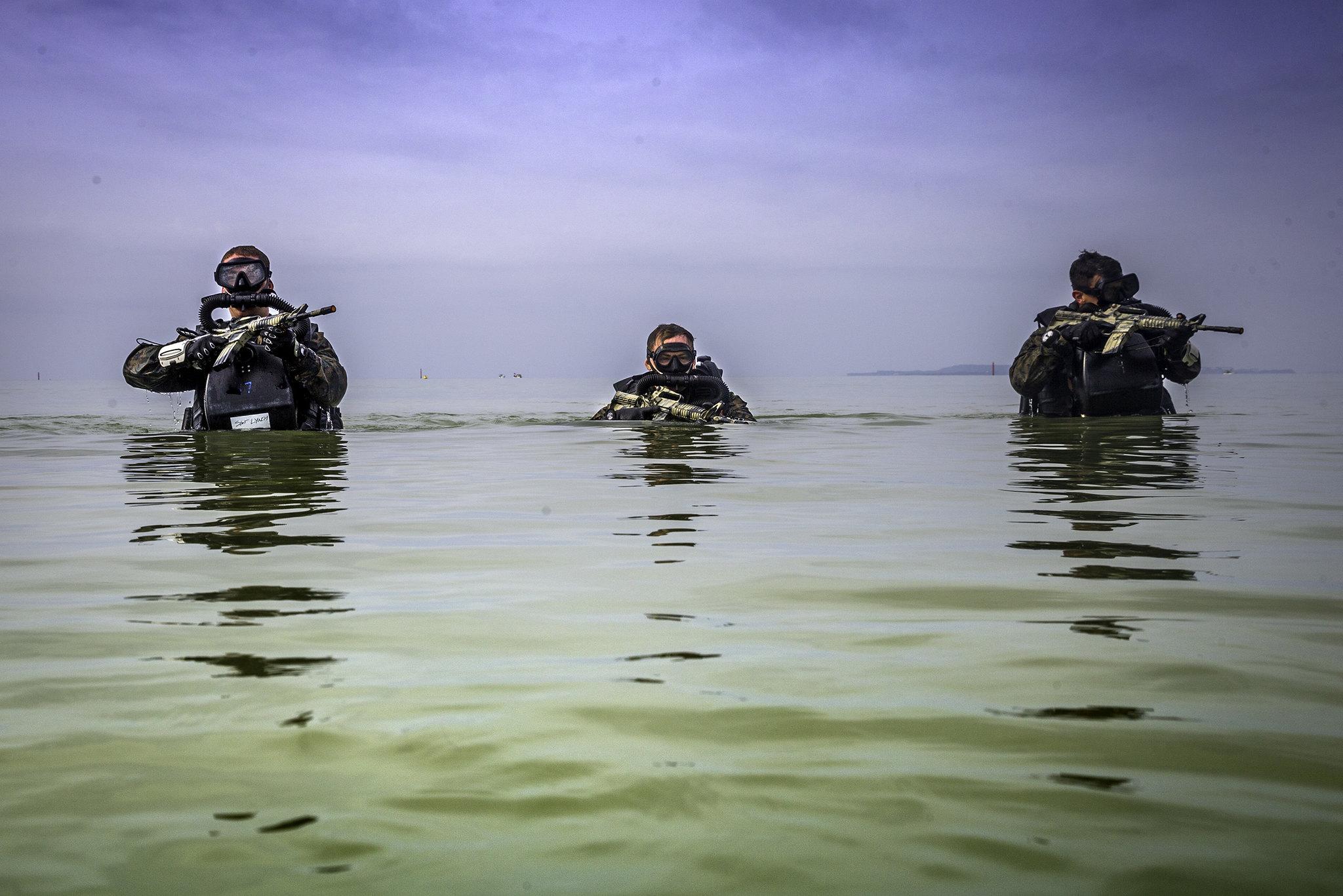 U.S. Marines patrol through water during a Marine Corps Combat Diving Supervisors Course on Camp Schwab, Okinawa, Japan, May 20, 2020. (Cpl. Savannah Mesimer/Marine Corps)