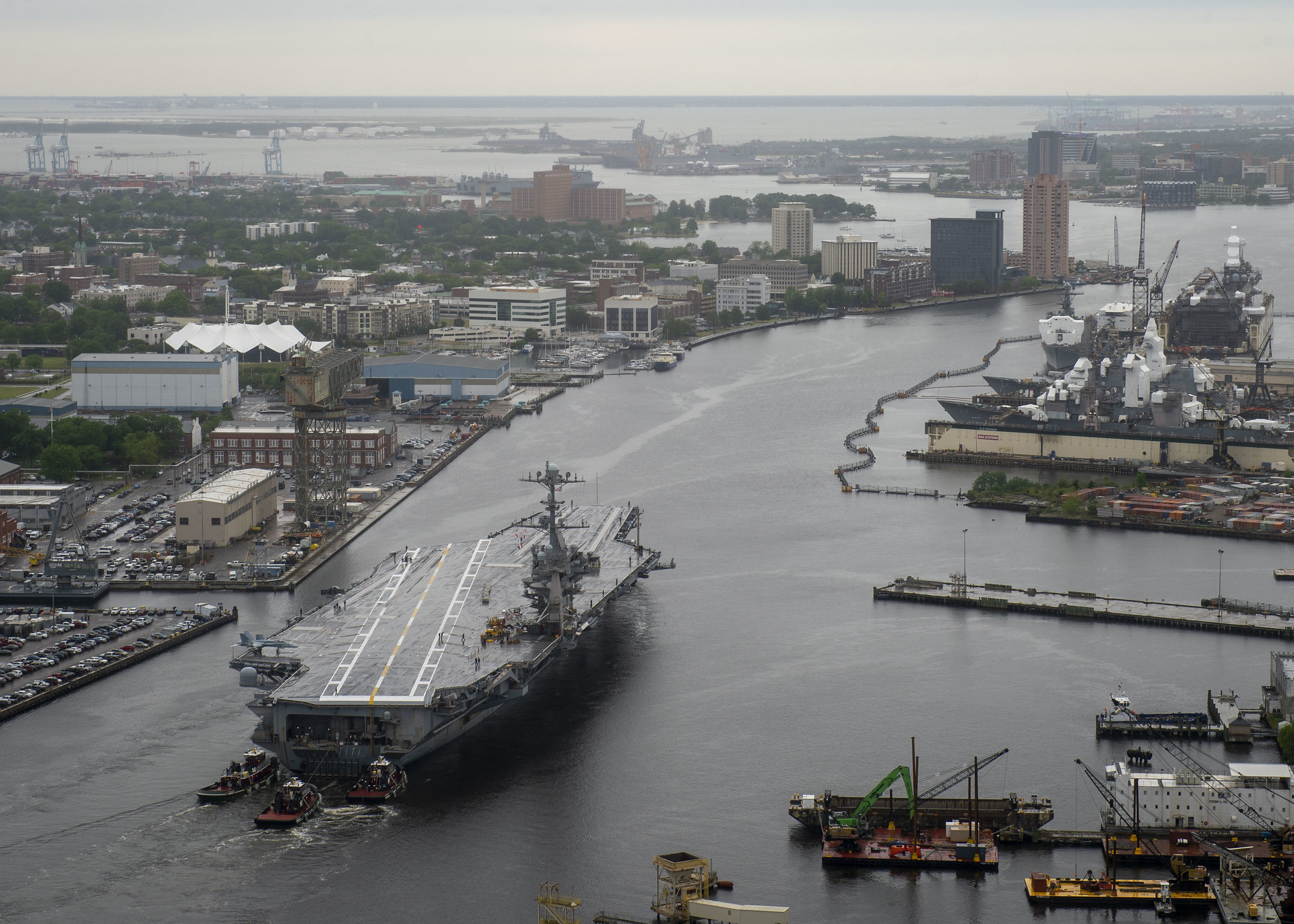 The aircraft carrier USS Harry S. Truman (CVN 75) transits the Elizabeth River on May 12, 2021, as it departs Norfolk Naval Shipyard in Portsmouth, Va., after completing a 10-month scheduled extended carrier incremental availability. (MC2 Class Steven Edgar/Navy)