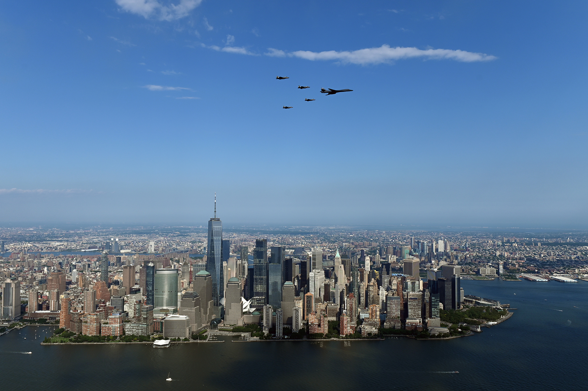 A B-1Lancer flies in formation with four F-35 Lightning II fighters over Manhattan as part of the