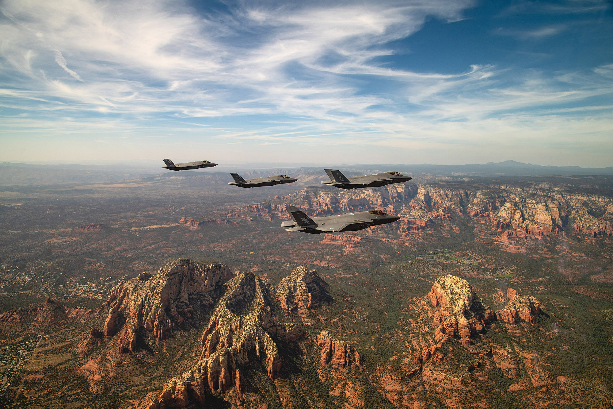 Two U.S. Air Force and two Royal Australian Air Force F-35A Lightning II's fly in formation during a commemoration flight Oct. 8, 2020, over Sedona, Ariz. The flight celebrated the partnership between the RAAF and U.S. Air Force in their joint efforts in training the world's most capable fighter pilots at Luke AFB. (Staff Sgt. Alexander Cook/Air Force)