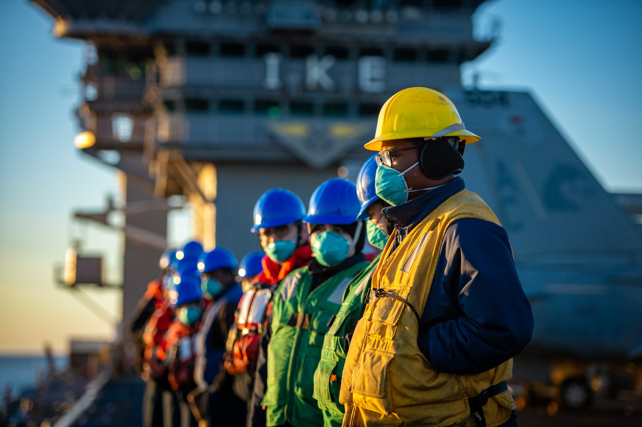 Sailors prepare for a replenishment-at-sea on Feb. 4, 2021, with the fleet-replenishment oiler USNS Kanawha (T-AO 196) onboard the Nimitz-class aircraft carrier USS Dwight D. Eisenhower (CVN 69) in the Atlantic Ocean. (Mass Communication Specialist Seaman Apprentice Mo Bourdi/Navy)