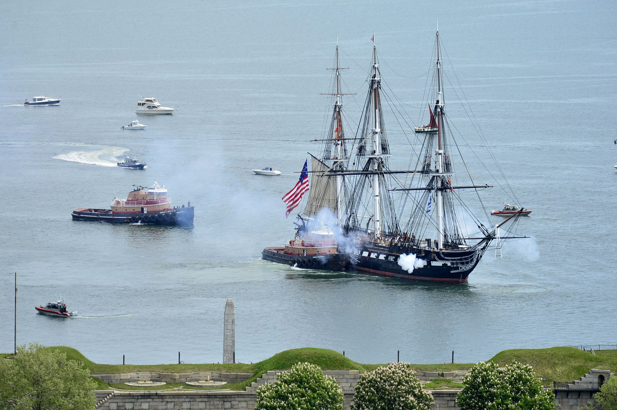 USS Constitution fires its cannons on May 22, 2021, as it is tugged through Boston Harbor. (MC3 Alec Kramer/Navy)