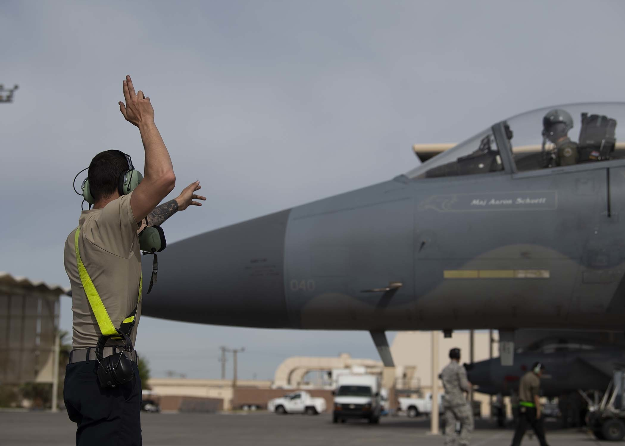 Airman 1st Class Dominik Roeglin, 757th Aircraft Maintenance Squadron crew chief, sends off an F-15C pilot at Nellis Air Force Base, Nev., April 8, 2019. The Air Force is buying the F-15EX jets to replace its oldest F-15C/Ds (Airman 1st Class Bryan Guthrie/U.S. Air Force)