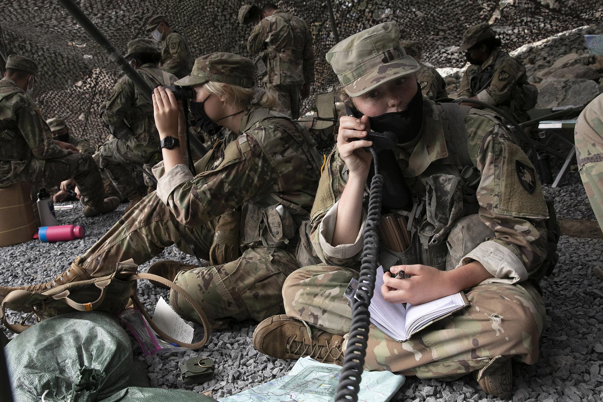 A cadet uses a field radio to call in live fire coordinates, Friday, Aug. 7, 2020, in West Point, N.Y. (Mark Lennihan/AP)