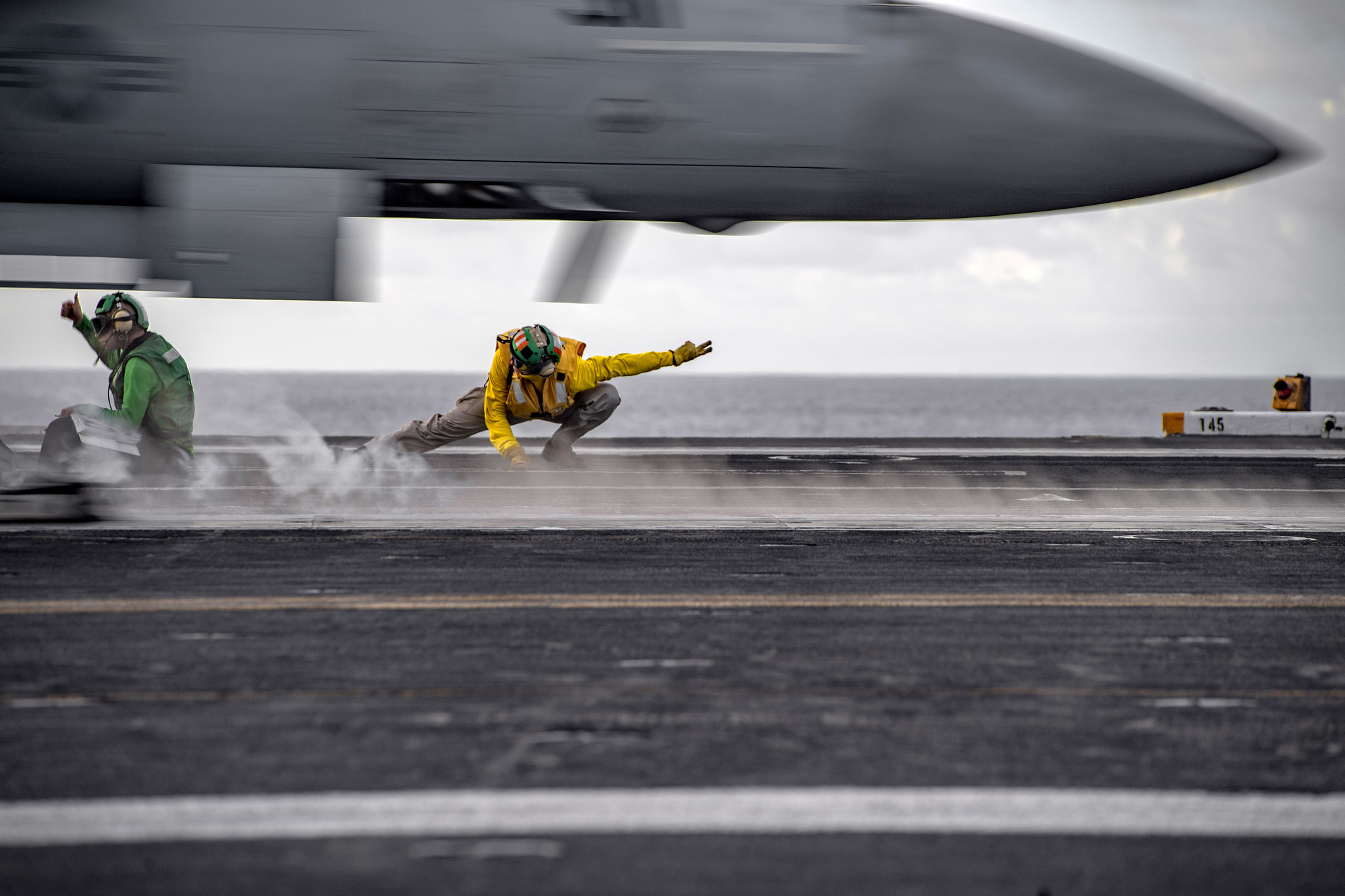 Sailors conduct flight operations aboard the aircraft carrier USS Nimitz (CVN 68) on June 28, 2020, in the Philippine Sea. The Nimitz and Ronald Reagan Carrier Strike Groups are conducting dual carrier operations in the Indo-Pacific as the Nimitz Carrier Strike Force. (MC3 Kyle Merritt/Navy)