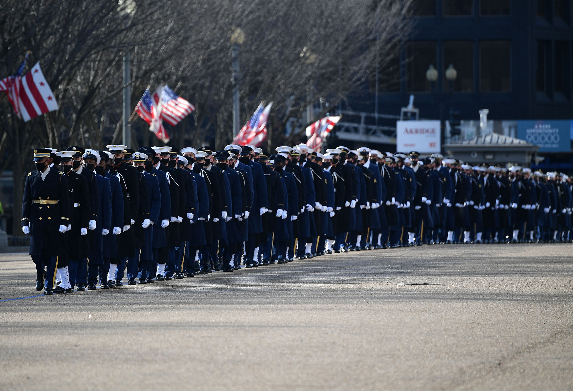 An honor guard deploys to line up along Pennsylvania Avenue in front of the White House in Washington on Jan. 20, 2021. (Mandel Ngan/AFP via Getty Images)