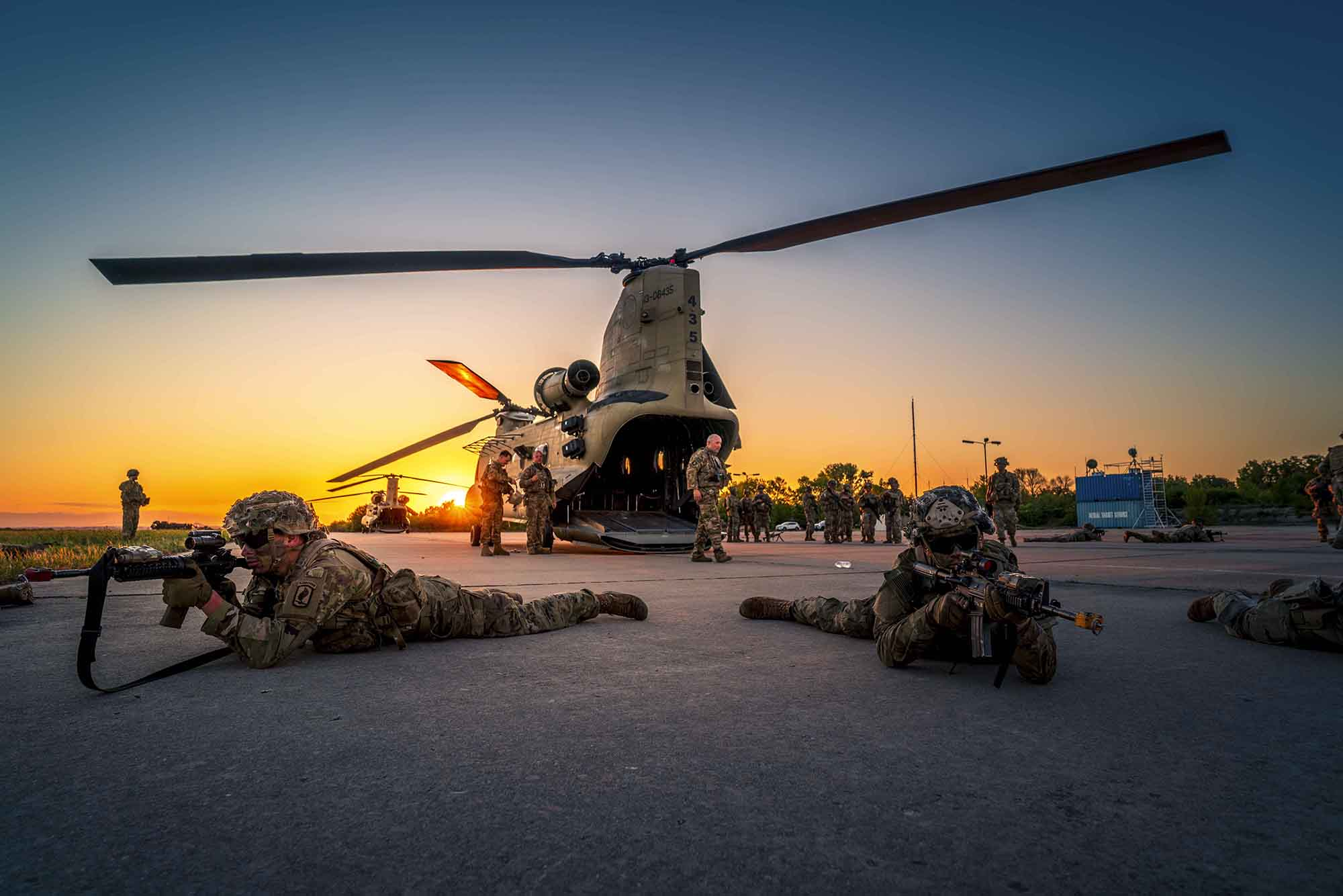 U.S. Army soldiers from the 173rd Airborne Brigade rehearse exiting CH-47 Chinooks of the 12th Combat Aviation Brigade in preparation for night air-assault missions during exercise Swift Response 21, part of the DEFENDER-Europe 21 series of exercises at Chech Airfield, Bulgaria, on May 11, 2021. (Maj. Robert Fellingham/U.S. Army)