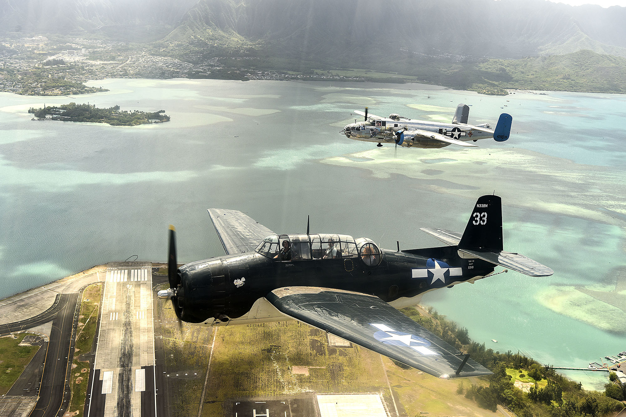 Vintage aircraft fly in formation over Oahu, Hawaii, on Sept. 1, 2020, for the 75th commemoration of the end of WWII. (Tech. Sgt. Anthony Nelson Jr./Air Force)