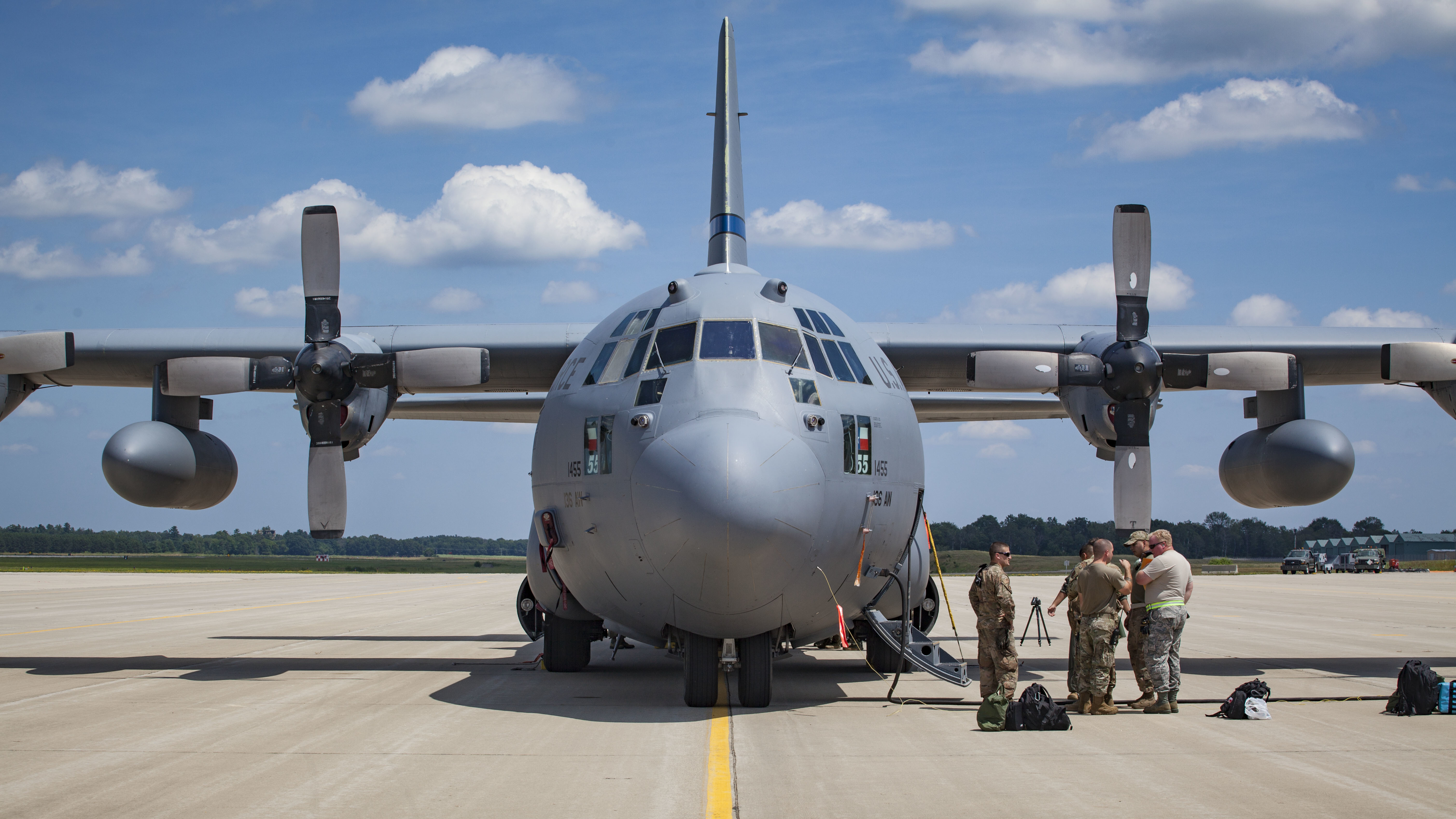 A C130 with the 136th Air Lift Wing, Texas Air National Guard, sit on the flight line as personnel depart at Volk Field Air National Guard Base during PATRIOT North 19 on July 12, 2019 in Camp Douglas, Wis. (Master Sgt. Kellen Kroening/U.S. Air National Guard)