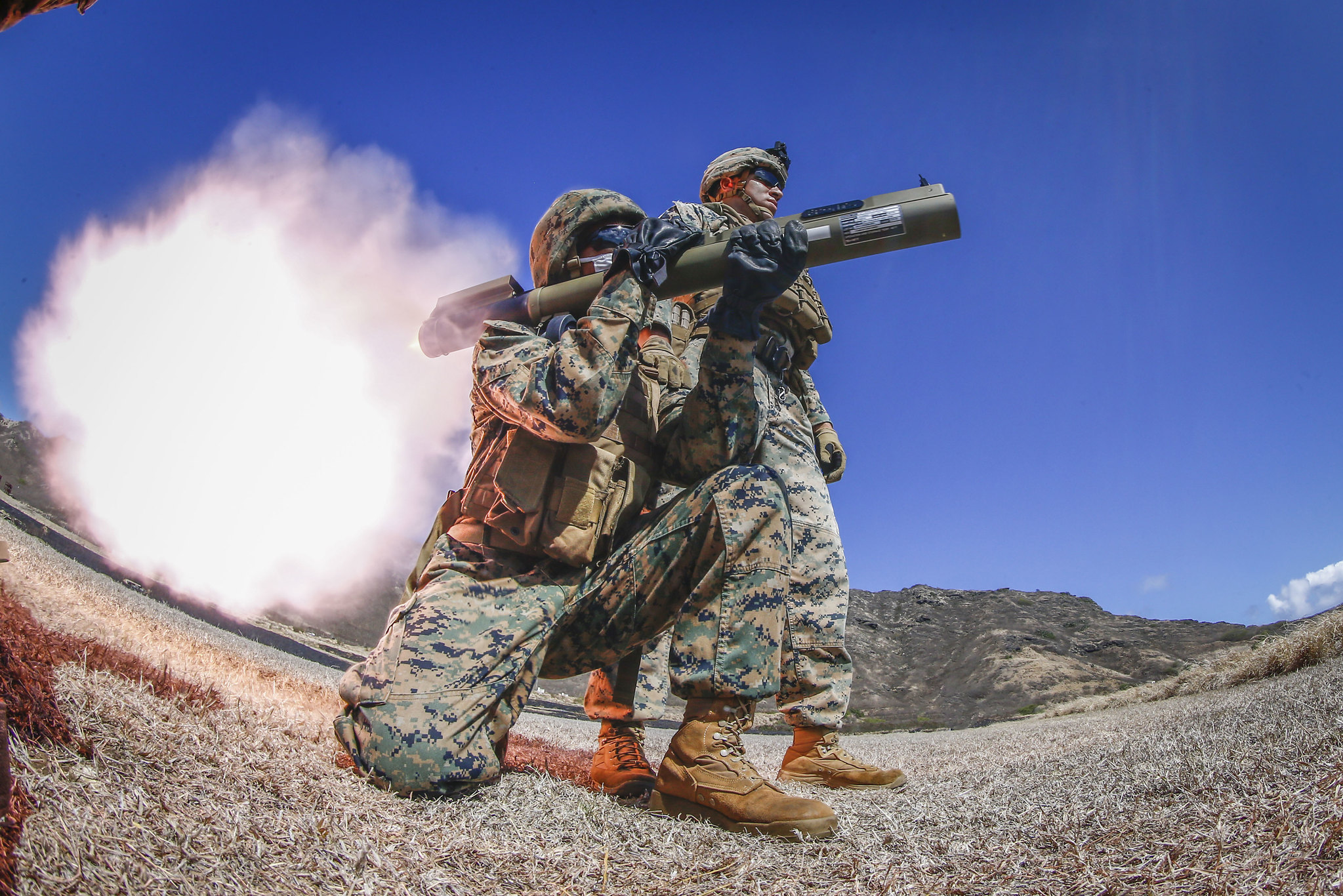 Sgt. Isaac Zimmerman observes as a Marine fire an M72 LAW weapon system at Marine Corps Base Hawaii, Aug. 13, 2020. (Sgt. Luke Kuennen/Marine Corps)