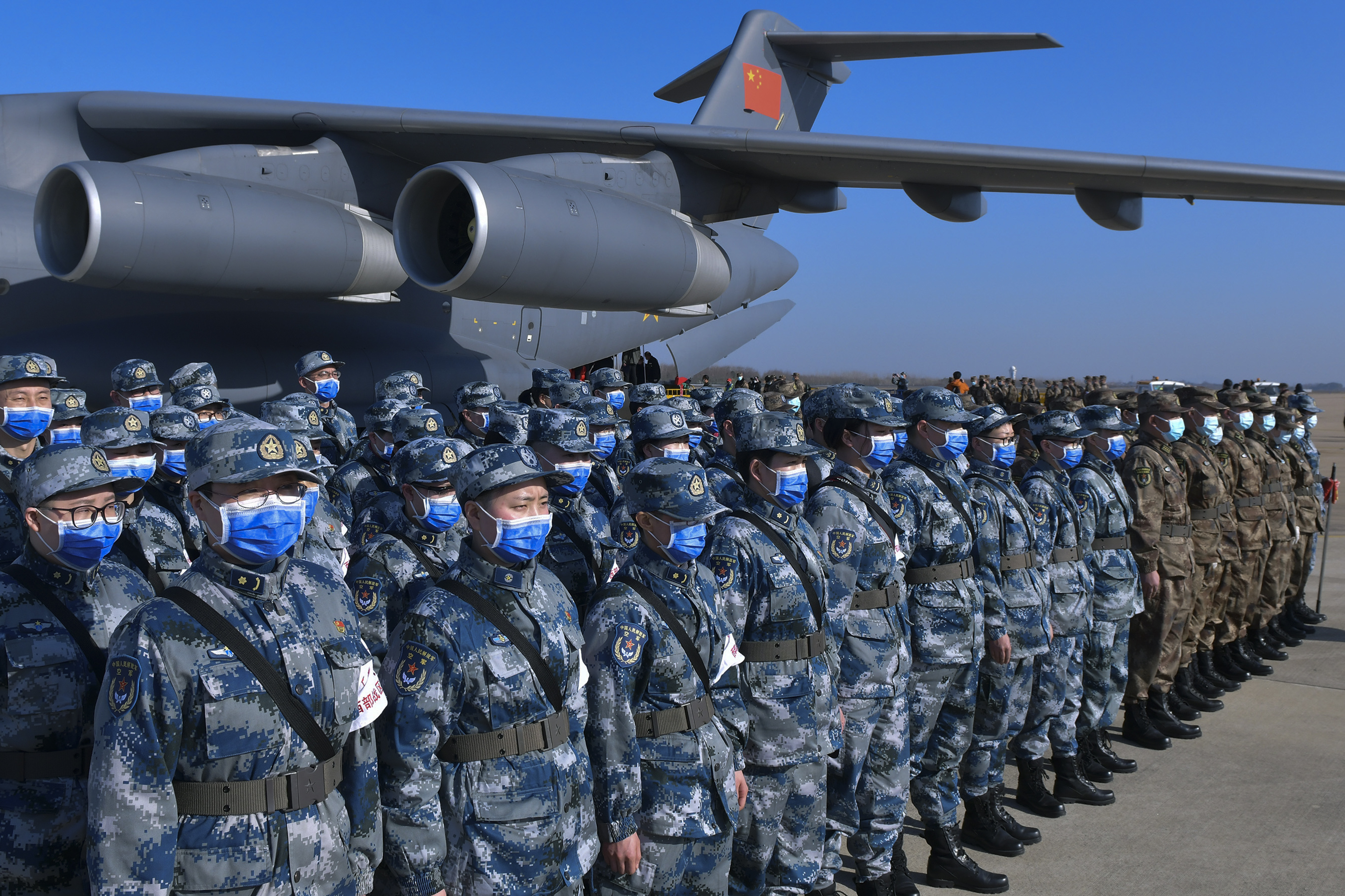 Military medics stand in formation on Feb. 17 as they arrive at Tianhe International Airport in Wuhan in central China's Hubei Province. (Li He/Xinhua via AP)